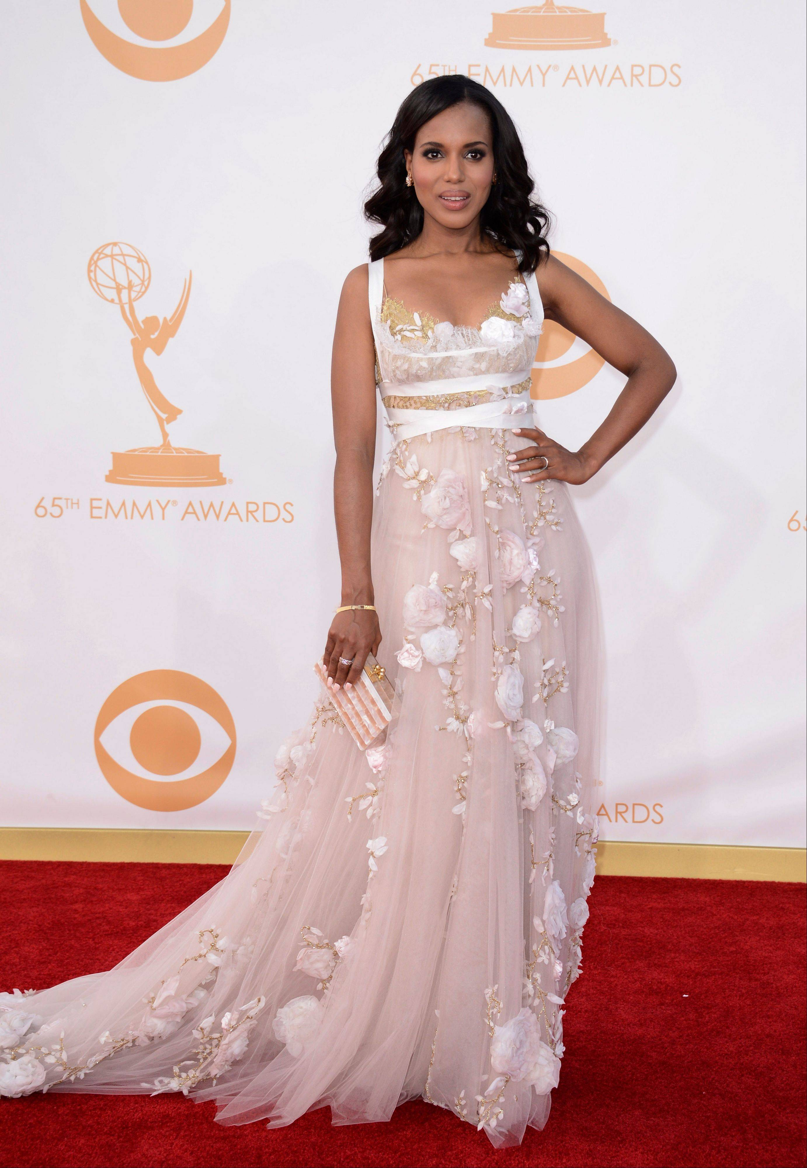 "This sept. 22, 2013 file photo shows actress Kerry Washington at the 65th Primetime Emmy Awards at Nokia Theatre in Los Angeles. In the realm where Hollywood meets fashion, Kerry Washington is royalty. On her hit show ""Scandal,"" playing professional fixer Olivia Pope, she was all professional Washington _ Washington, D.C., that it _ but on the red carpet, she was glamour personified."