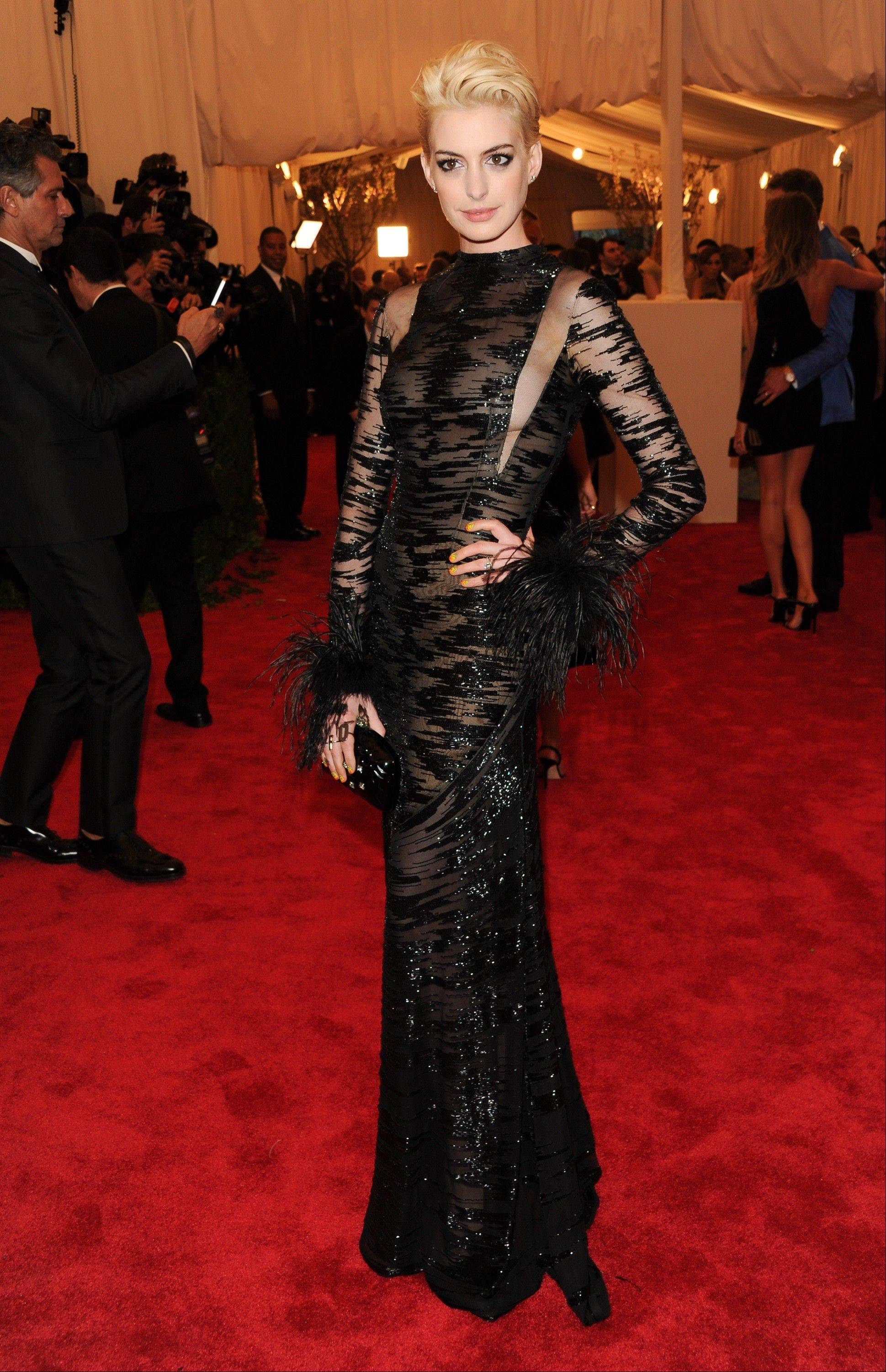 "This May 6, 2013 file photo shows actress Anne Hathaway atThe Metropolitan Museum of Art Costume Institute gala benefit, ""Punk: Chaos to Couture"" in New York. The Metropolitan Museum of Art hosted a new Costume Institute exhibit, ""Punk: Chaos to Culture,"" celebrating a movement that embraced anarchy in the 1970s. (Photo by Evan Agostini/Invision/AP, File)"
