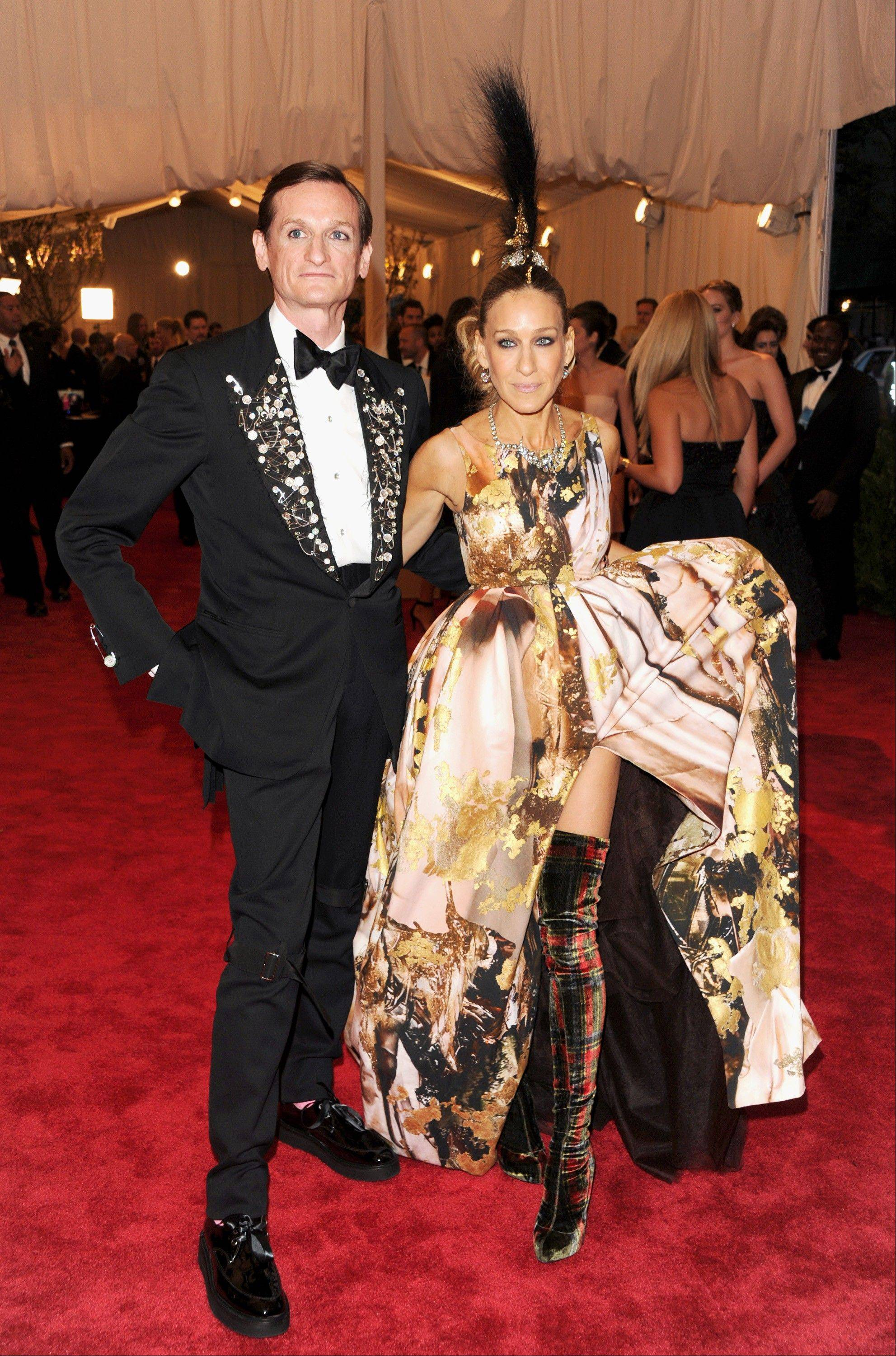 "This May 6, 2013 file photo shows Hamish Bowles, left, and Sarah Jessica Parker at The Metropolitan Museum of Art Costume Institute gala benefit, ""Punk: Chaos to Couture"", in New York. The Metropolitan Museum of Art hosted a new Costume Institute exhibit, ""Punk: Chaos to Culture,"" celebrating a movement that embraced anarchy in the 1970s."
