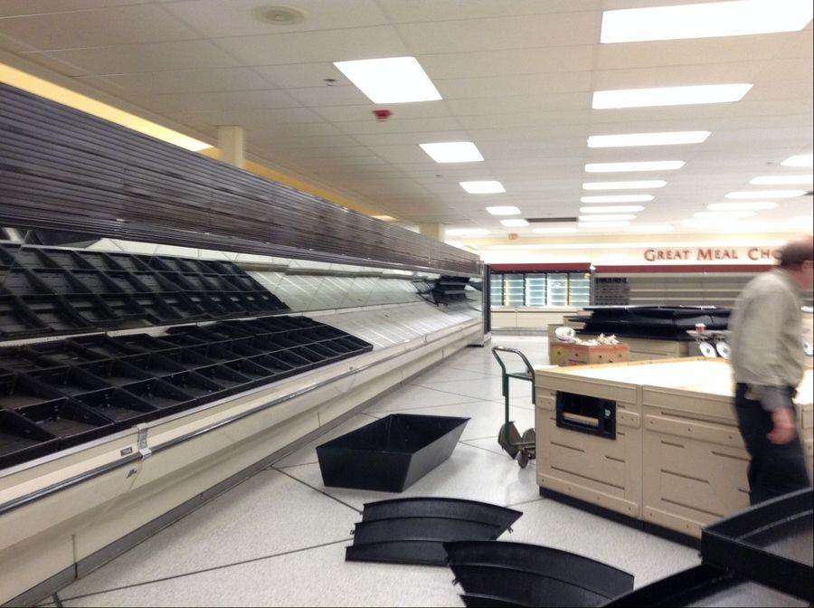An employee skeleton crew on Saturday cleaned the now bare Dominick's at Meacham and Higgins roads in Schaumburg. The store was among 72 in the Chicago area which parent company Safeway shuttered.