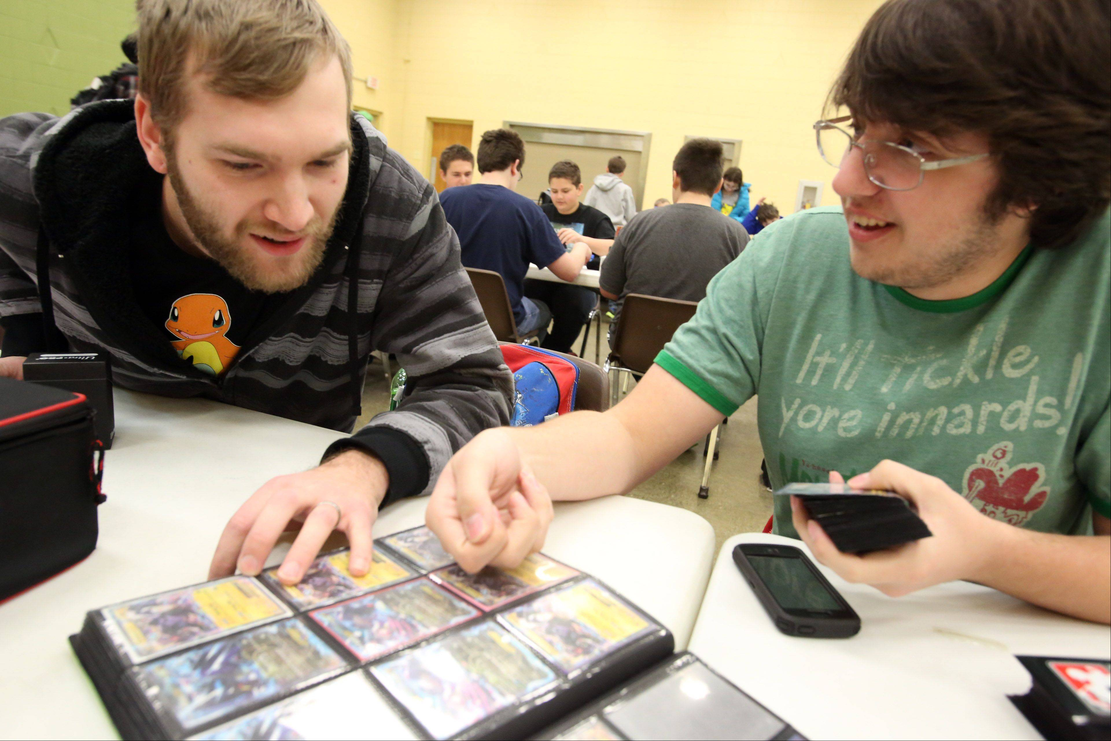 Tyler Lamb of Montgomery, left, trades cards with Steven Vlosak of Downers Grove at the Pokémon City Championships at the Huntley Park District on Saturday in Huntley.