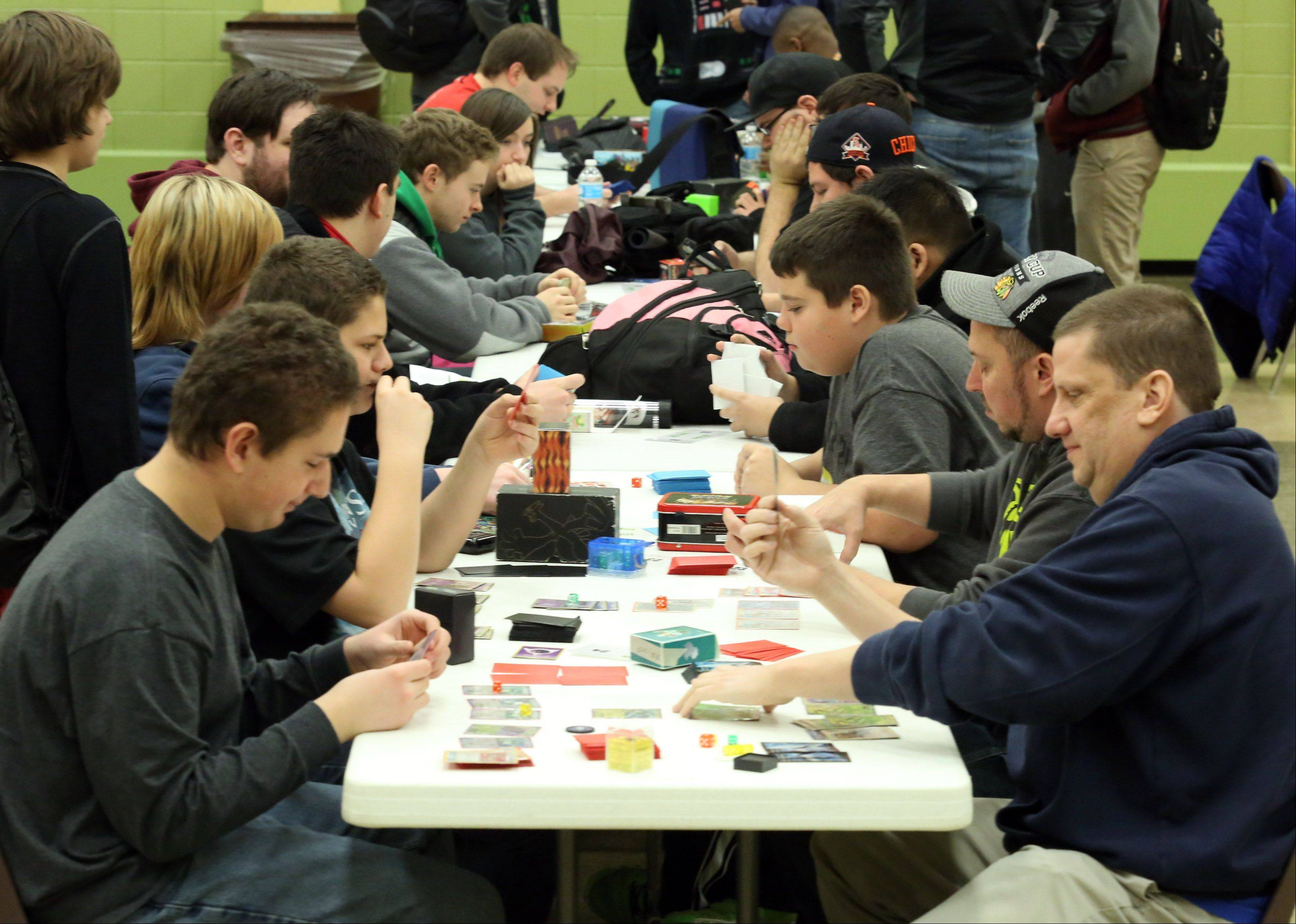 About 60 people competed in the Pokémon City Championships, according to organizer Jimmy Ballard of Plainfield, second from front at right.