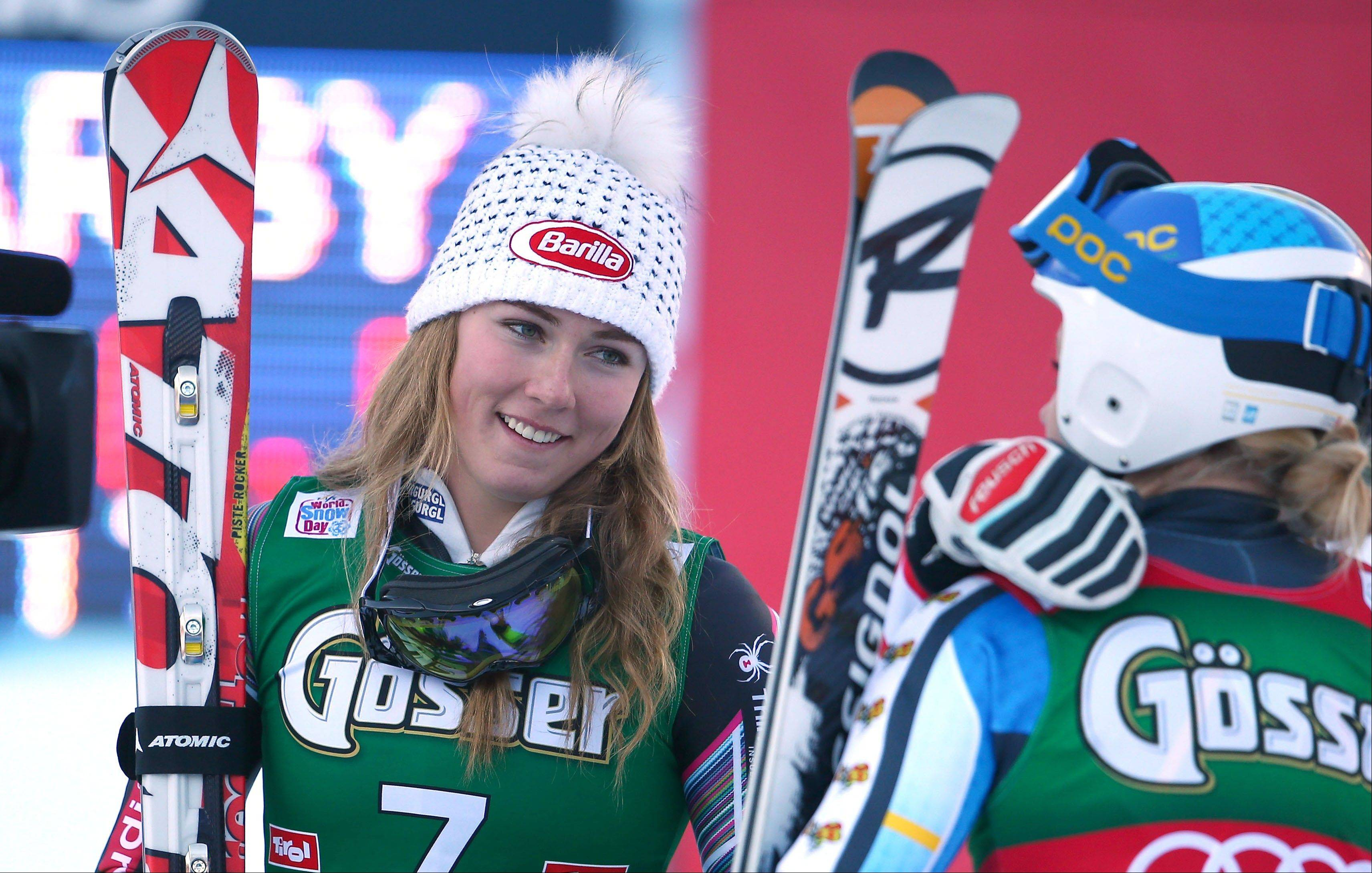 Associated PressMikaela Shiffrin of the United States celebrates her third place in an alpine ski, women's World Cup giant slalom, in Lienz, Austria, Saturday, Dec. 28.