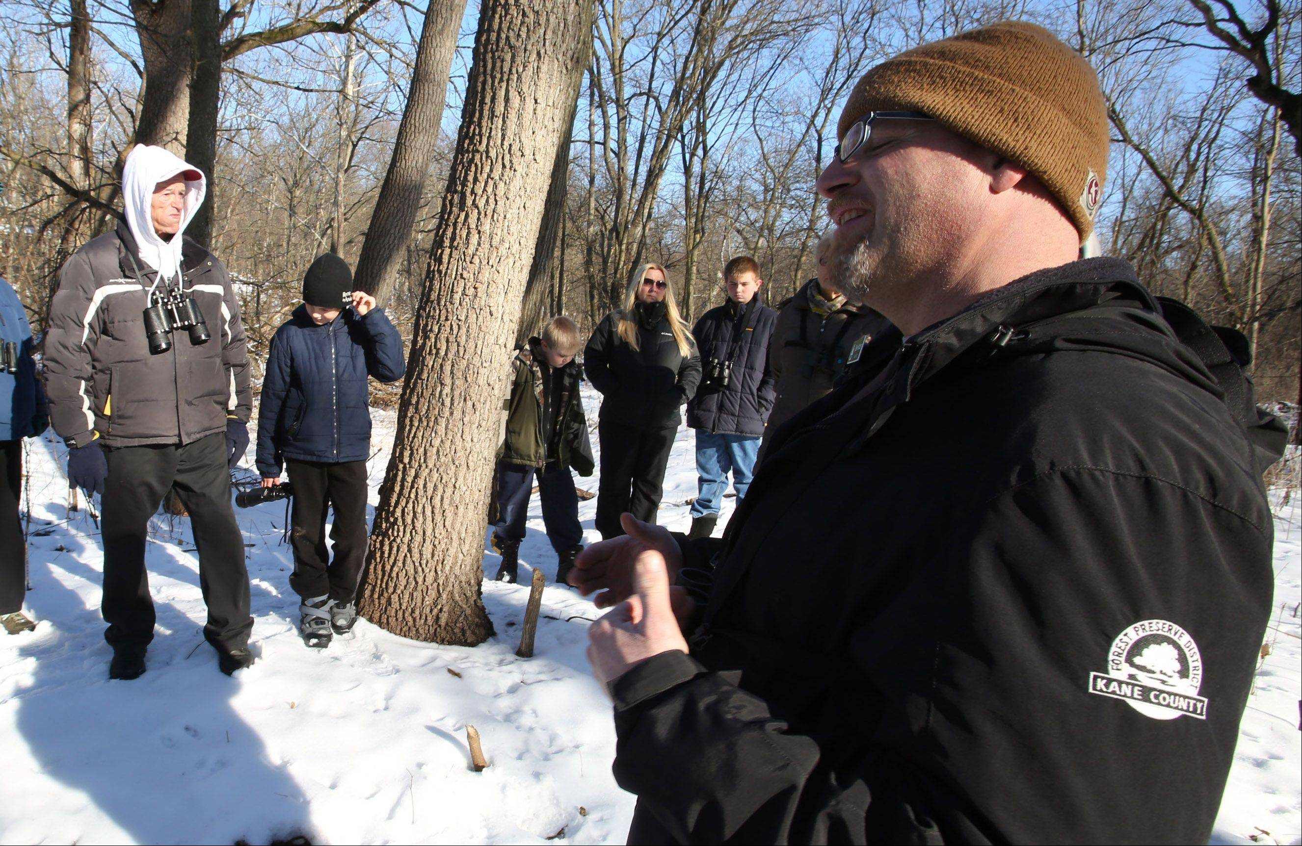 Kane County Forest Preserve naturalist Ben Katzen gives tips on how to spot birds in the winter at Creek Bend Nature Center during a Winter Birds program on Saturday in St. Charles.
