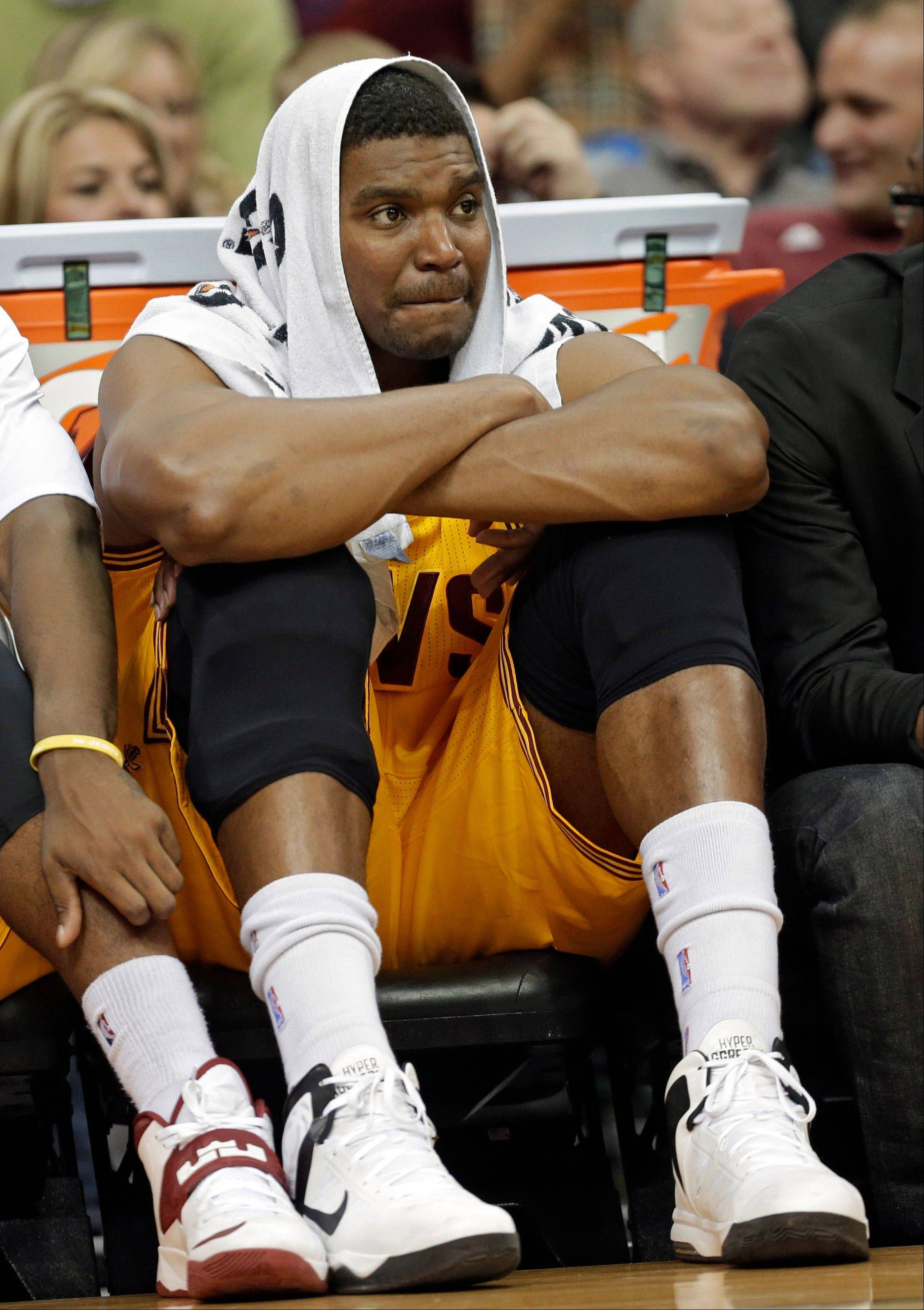 Associated Press In this Nov. 20 photo, Cleveland Cavaliers' Andrew Bynum watches form the bench during an NBA basketball game against the Washington Wizards in Cleveland. Bynum has been suspended indefinitely from the team for detrimental conduct and banned from all team activities. Bynum, who signed a two-year, $12 million contract with the Cavs this summer, did not travel with the team to Boston for Saturday's game.