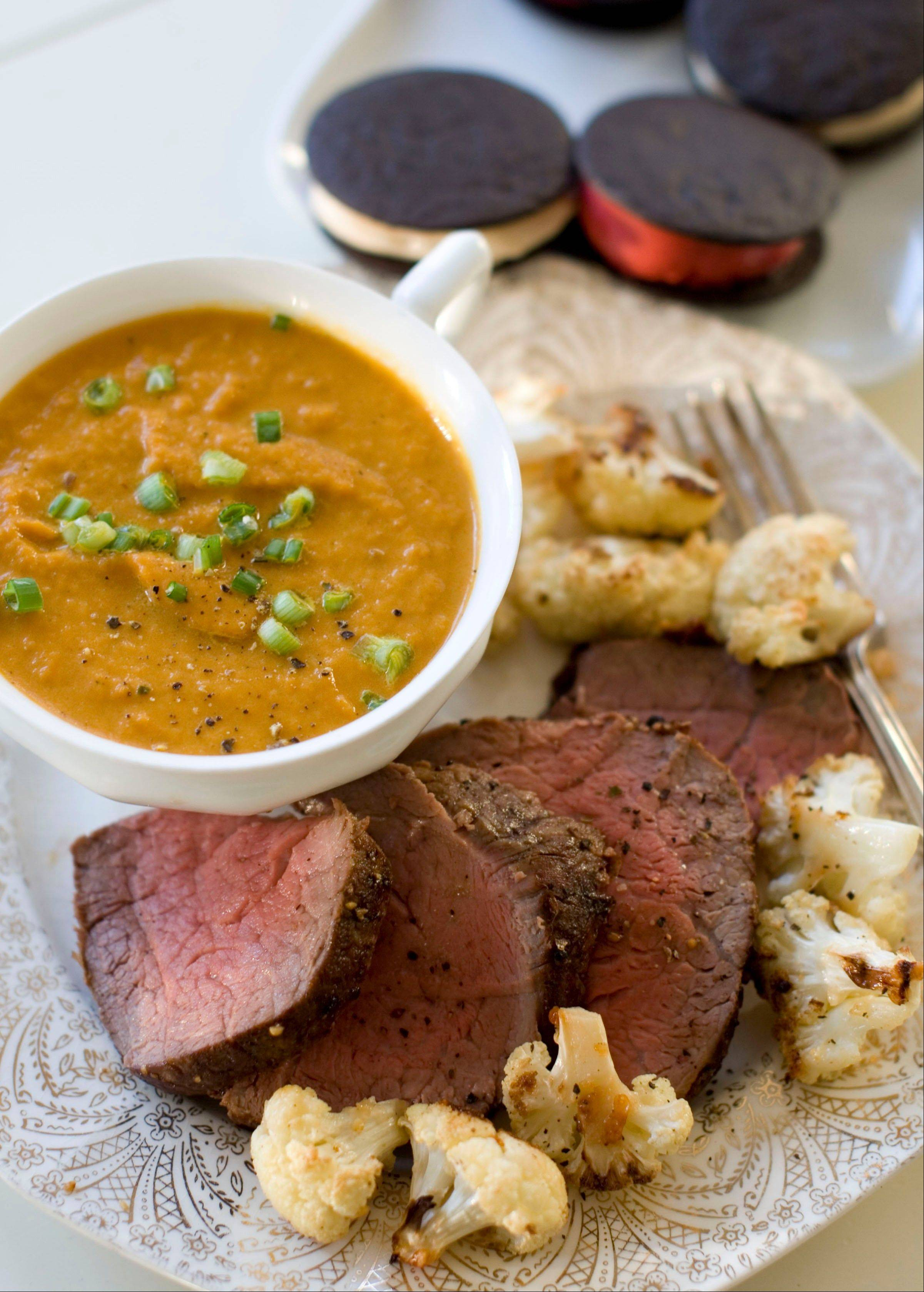 For a classic dinner without complicated prep, try spiced carrot soup, peppered filet roasted with parmesan roasted cauliflower and chocolate sorbet sandwiches.