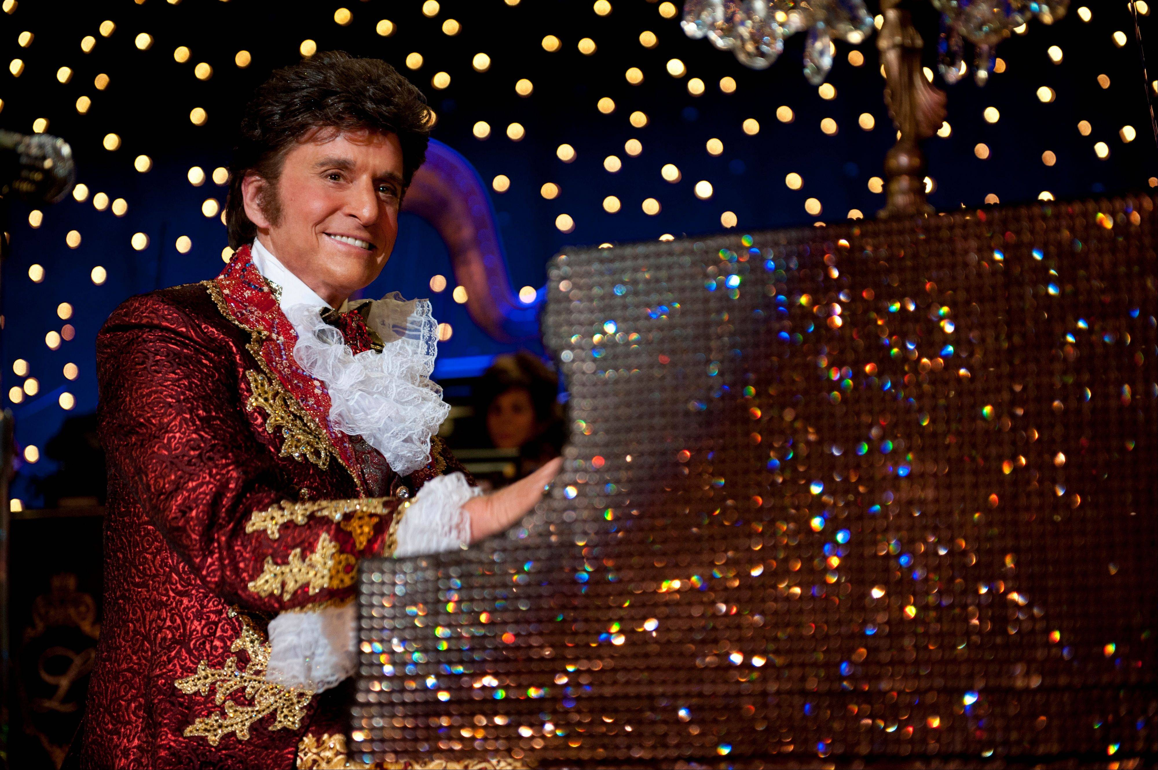 "This film image released by HBO shows Michael Douglas as Liberace in a scene from ""Behind the Candelabra."" his splashy and poignant portrait of ""Mr. Showmanship,"" Liberace, proved a dual career triumph for Michael Douglas, who portrayed him, and Matt Damon, who was no less impressive as the Vegas superstar's tempestuous lover."