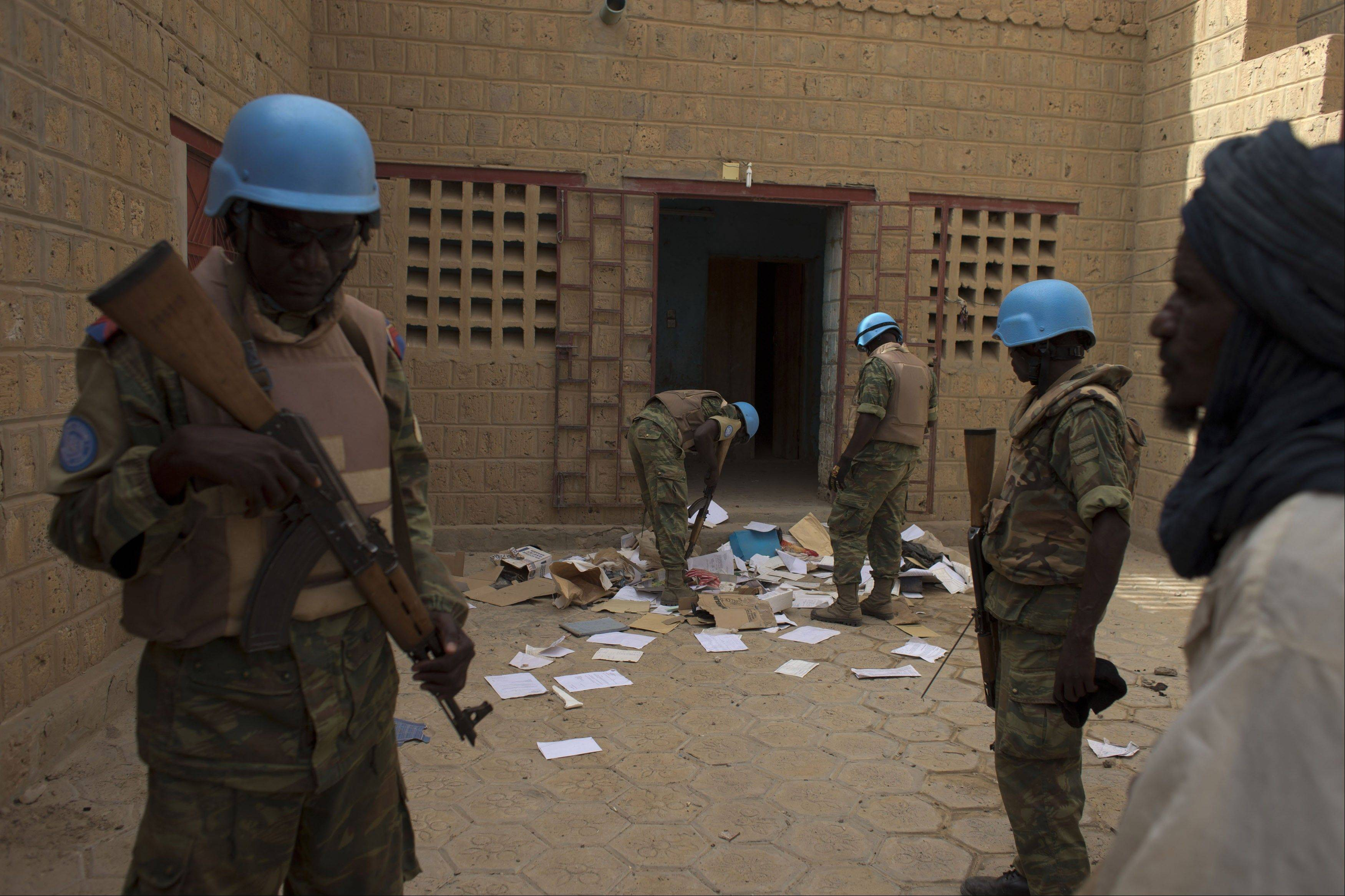 United Nations peacekeepers search a house suspected to have been used by members of al-Qaida�s North African branch in Timbuktu, Mali, july 23. The al-Qaida cell occupied Timbuktu for 10 months until January 2013. When they fled, they left behind thousands of pages of documents.