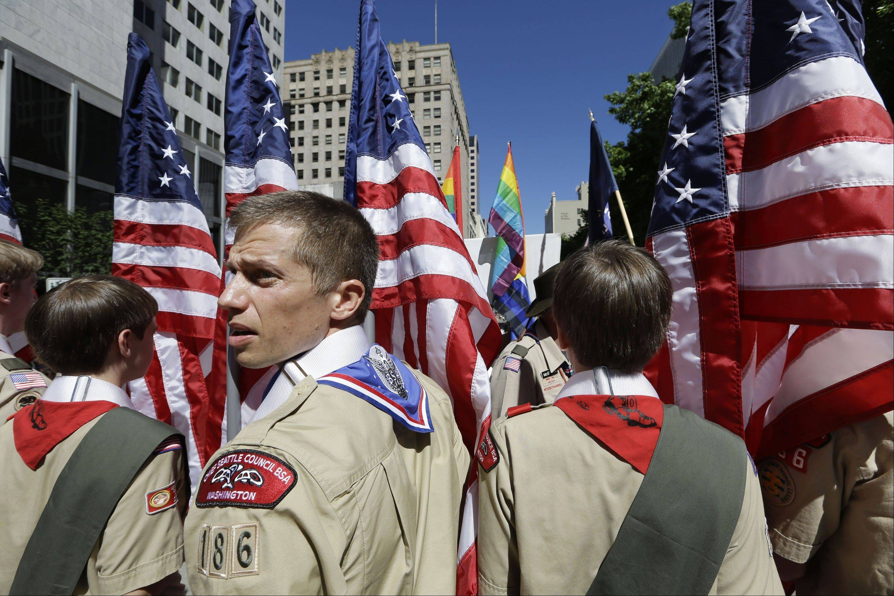 Boy Scouts from the Chief Seattle Council carry U.S. flags as they prepare to march in the Gay Pride Parade in downtown Seattle. The Boy Scouts of America, in the most contentious change of membership policy in a 103-year history, will accept openly gay youths in Scout units starting on New Year�s Day 2014.