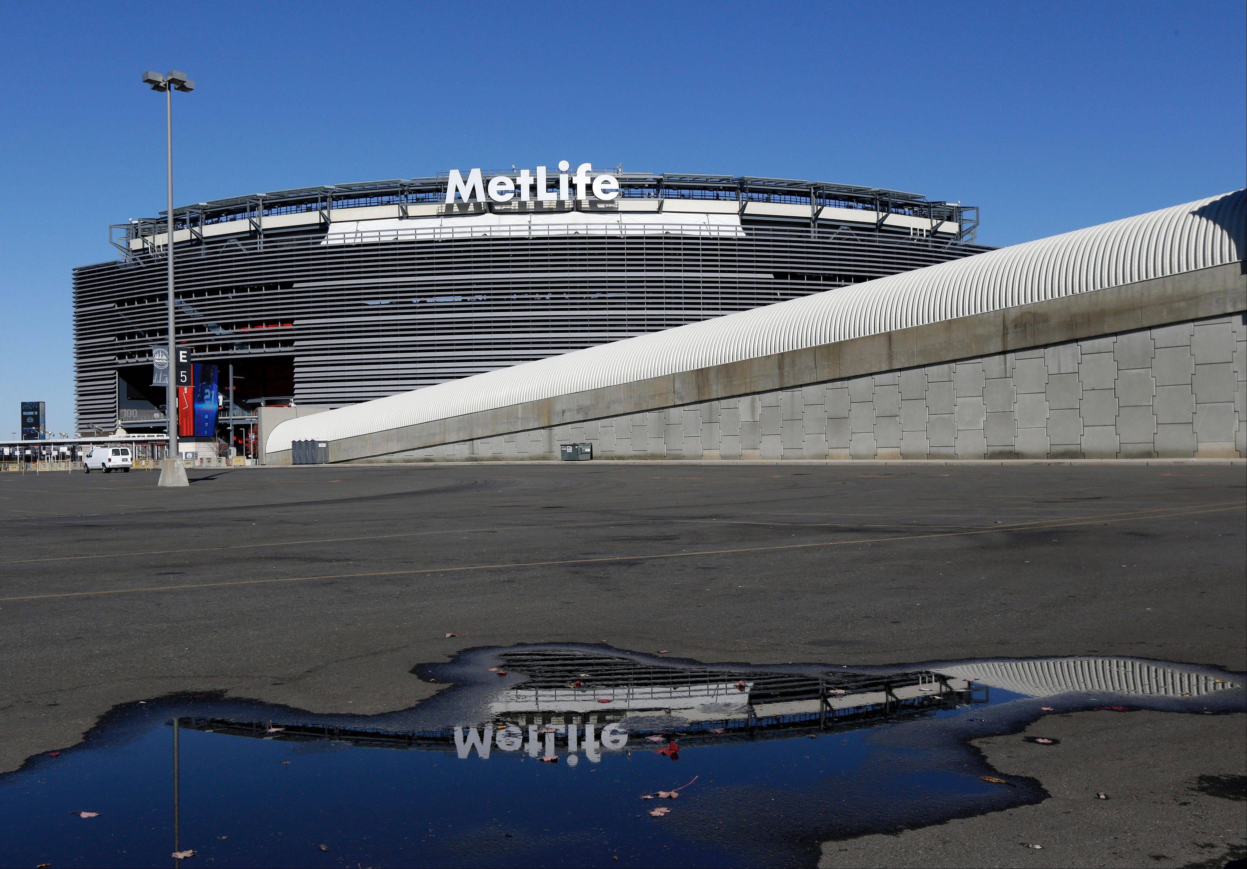 MetLife Stadium is reflected on a puddle on the stadium's parking lot in East Rutherford, N.J. Northern New Jersey towns hoping to get Super Bowl visitors to spend time and money in the Garden State, and not just across the river in Manhattan, realize they need to come up with a creative game plan to separate itself from New York.