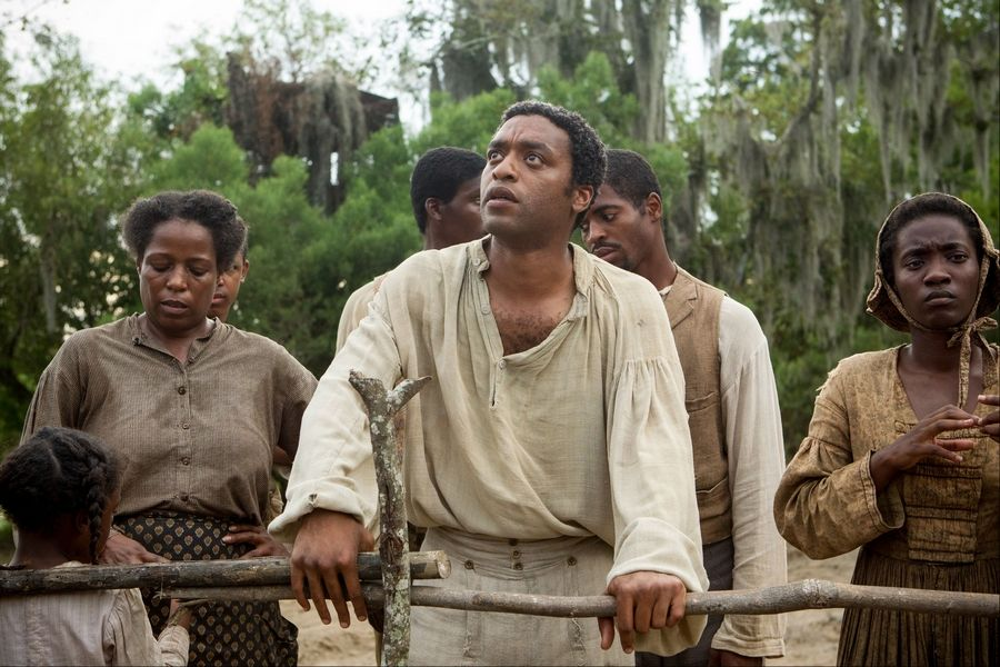 "Chiwetel Ejiofor, center, stars in ""12 Years A Slave."""