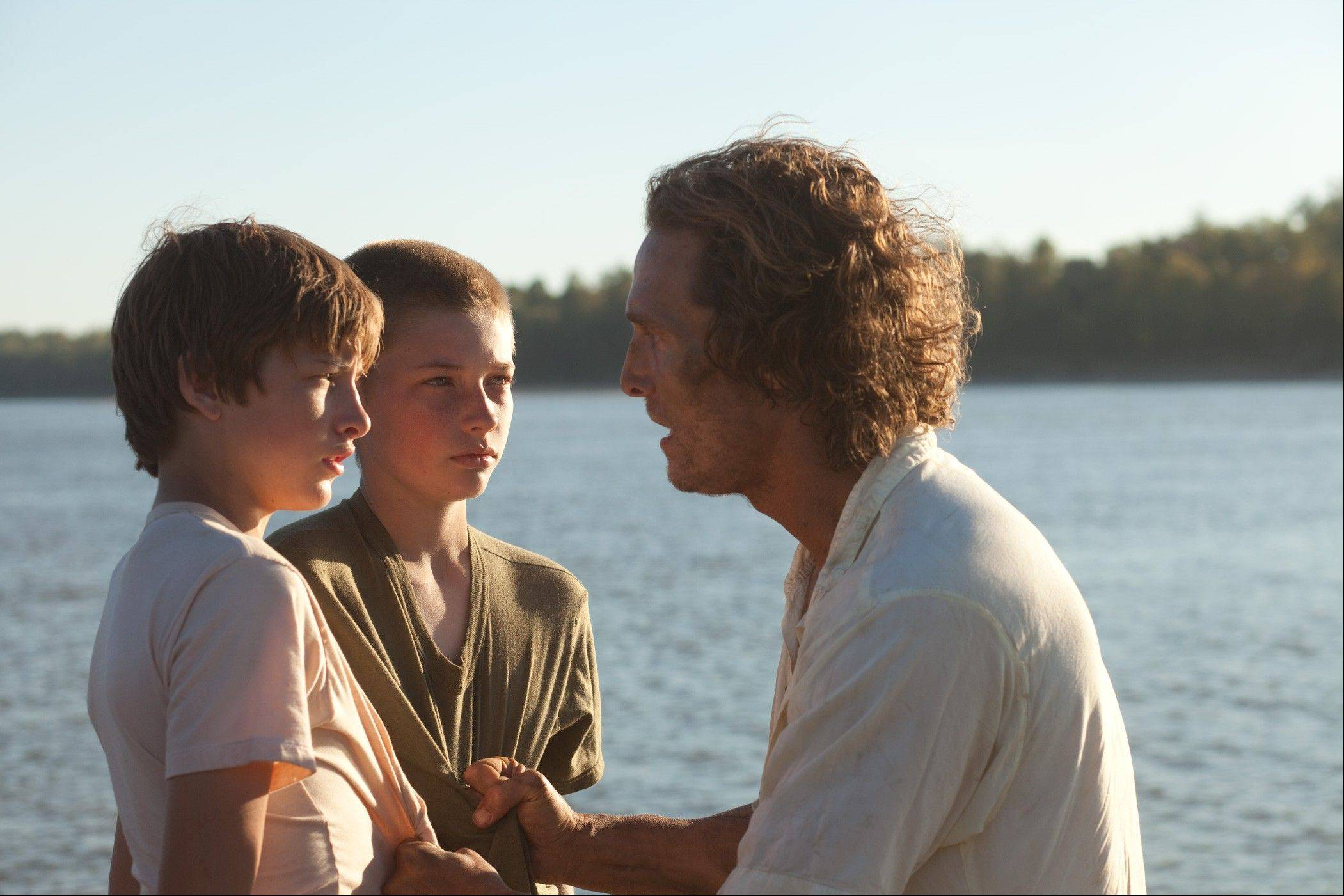 "This file film image released by Roadside Attractions shows Tye Sheridan, left, Jacob Lofland, and Matthew McConaughey, right, in a scene from ""Mud."""
