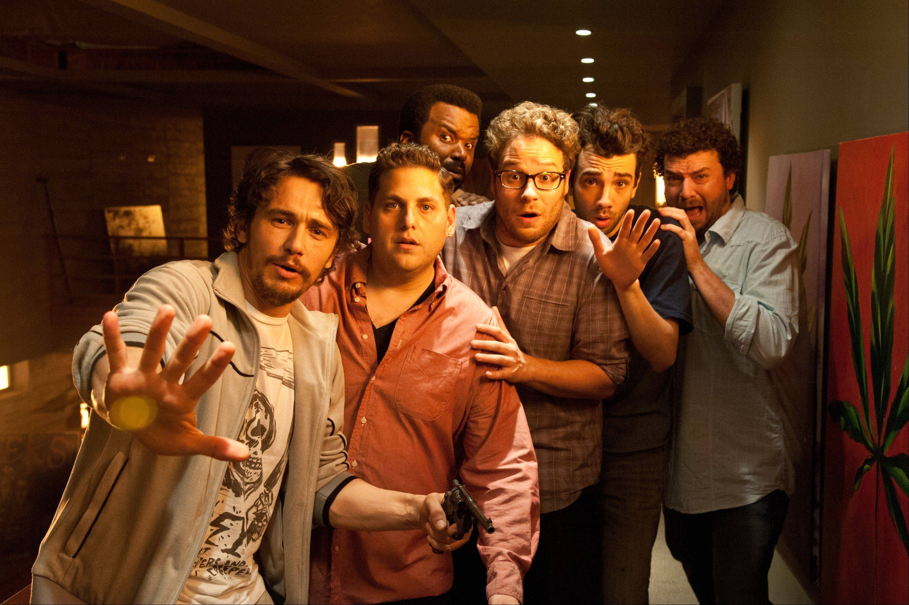"This file photo released by Sony Pictures shows, from left, James Franco, Jonah Hill, Craig Robinson, Seth Rogen, Jay Baruchel and Danny McBride in ""This Is The End."""