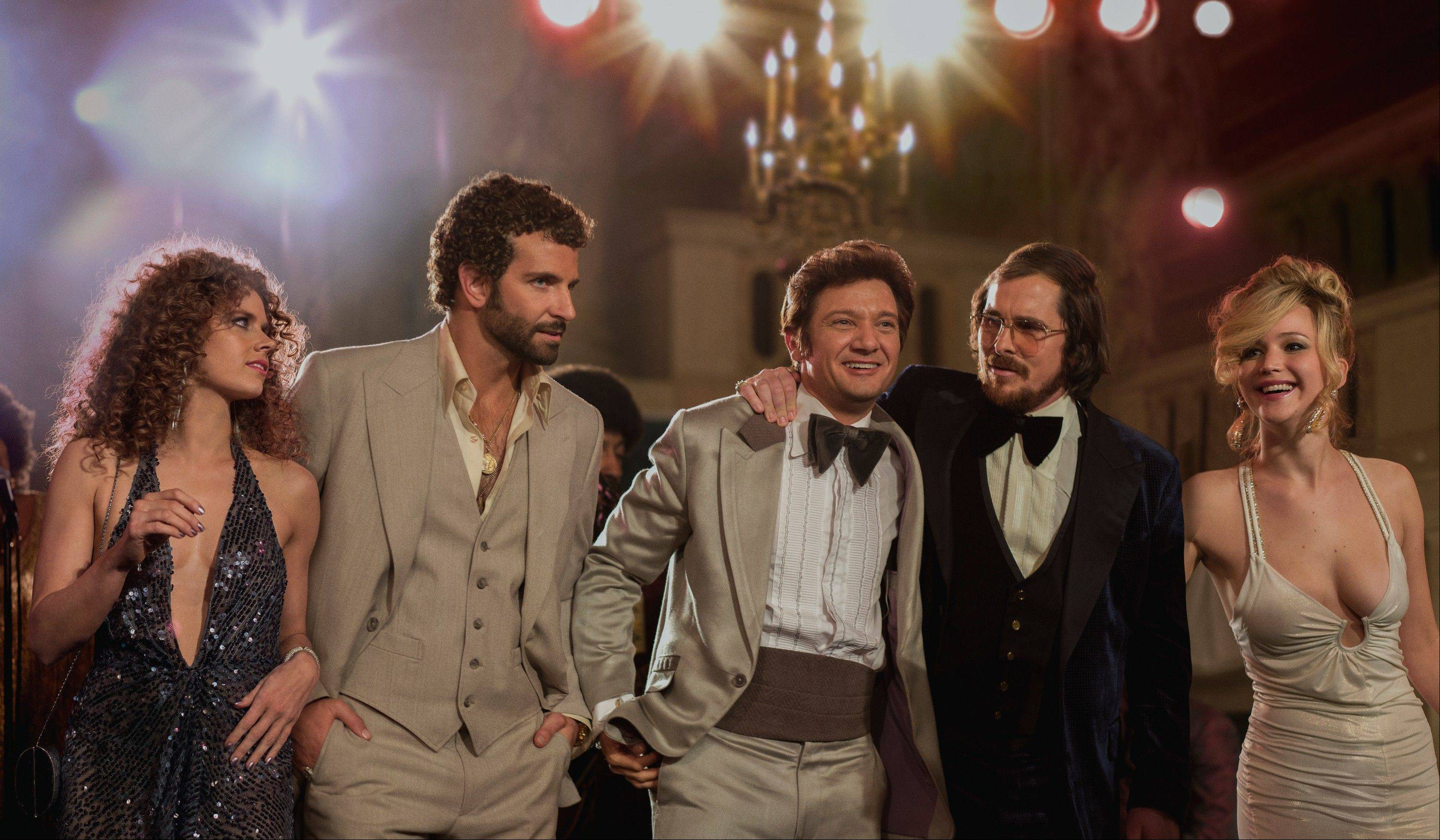 "This film image released by Sony Pictures shows, from left, Amy Adams, as Sydney Prosser, Bradley Cooper, as Richie Dimaso, Jeremy Renner, as Mayor Carmine Polito, Christian Bale as Irving Rosenfeld, and Jennifer Lawrence as Rosalyn Rosenfeld, in a scene from ""American Hustle."""