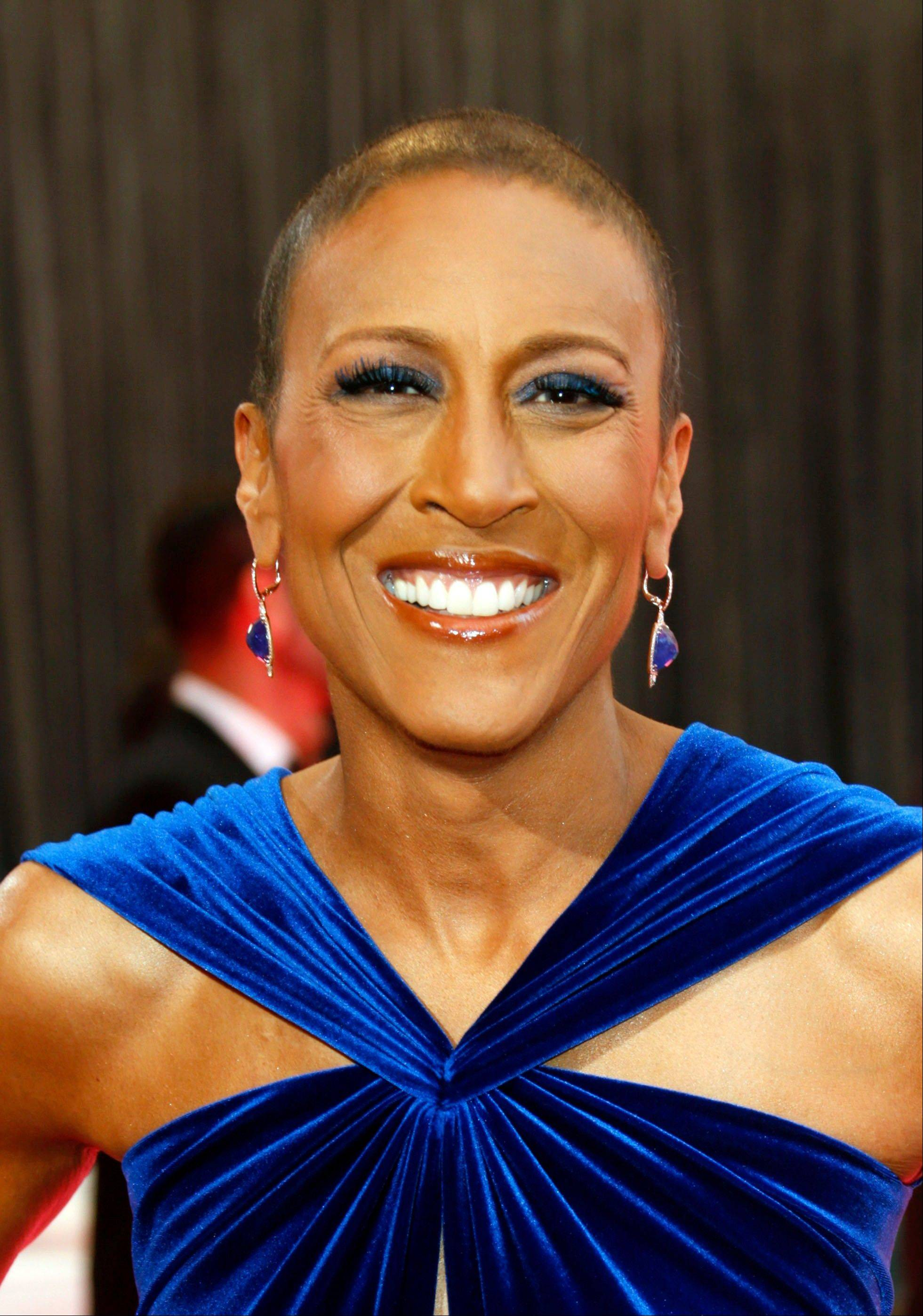 "This Feb. 24, 2013 file photo shows broadcaster Robin Roberts arriving at the 85th Academy Awards at the Dolby Theatre in Los Angeles. Roberts thanked her longtime girlfriend, Amber Laign, in a year-end post published on the ABC News anchor�s Facebook page on Sunday, Dec. 29, 2013. The message comes after Roberts' battle with a life-threatening illness. This is the first time the ""Good Morning America"" anchor has publicly acknowledged her 10-year, same-sex relationship with Laign, a massage therapist from the San Francisco Bay Area, who focuses on patients recovering from injuries."