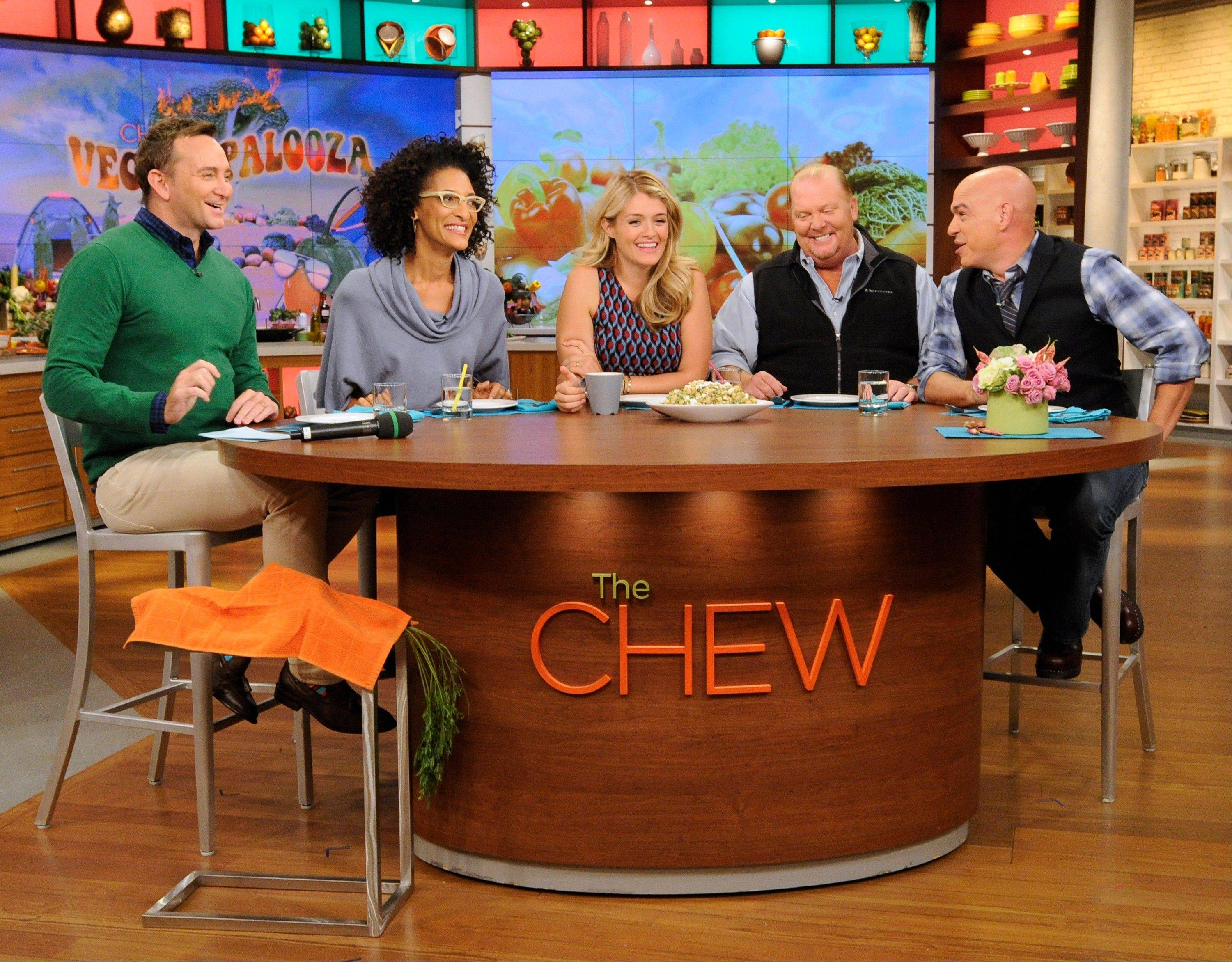 "The hosts of ""The Chew,"" from left, Clinton Kelly, Carla Hall, Daphne Oz, Mario Batali and Michael Symon, marked the 500th edition of ABC's ""The Chew"" on Dec. 3 with a special live hour."