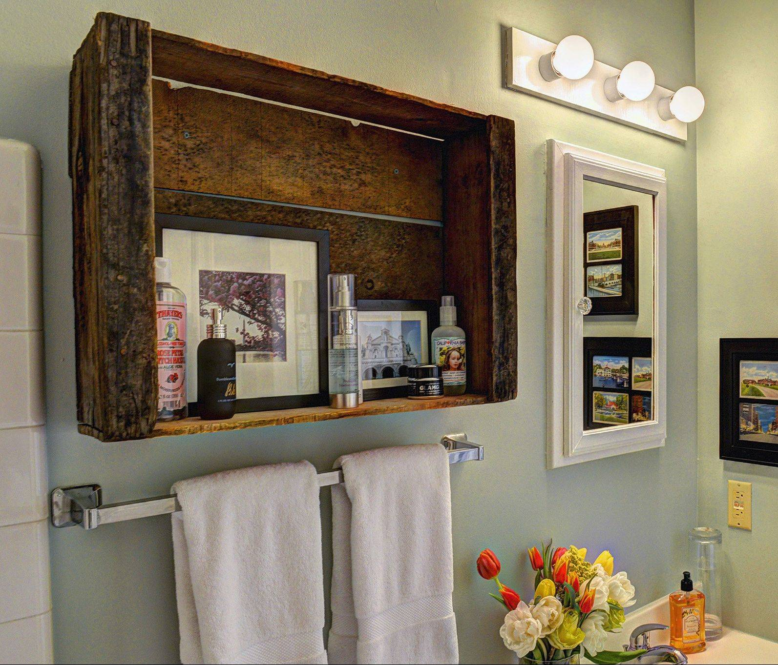 Huerta bought a vintage wooden grape crate on Etsy and hung it on the bathroom wall for extra storage.