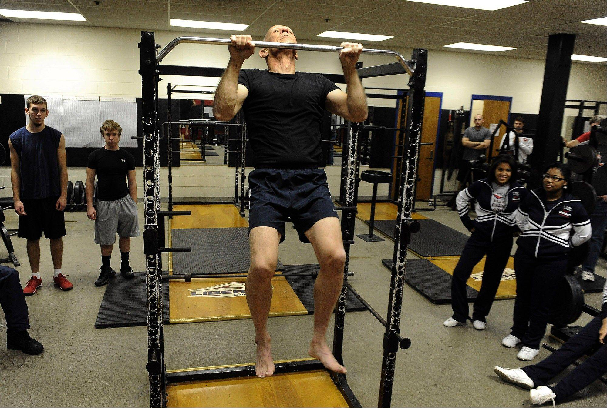 Photo by Richard A. Lipski/Washington Post  Dan Durante, 70, does 39 pullups in 53 seconds (hey, everybody has an off day now and then, right?) as part of a fundraiser for Liberty High School.