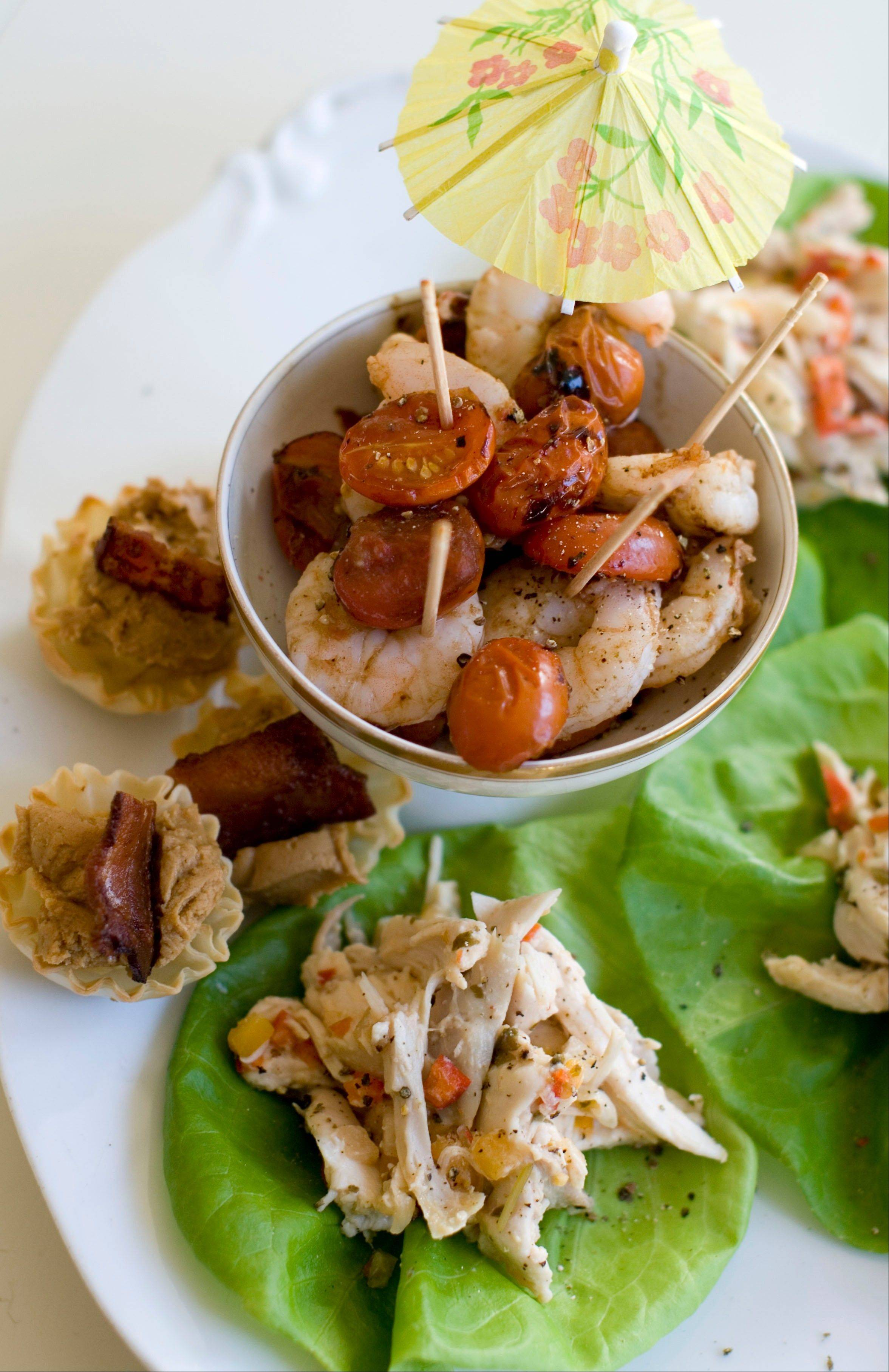 Roasted shrimp cocktail, pineapple chicken lettuce wraps and Elvis phyllo cups.