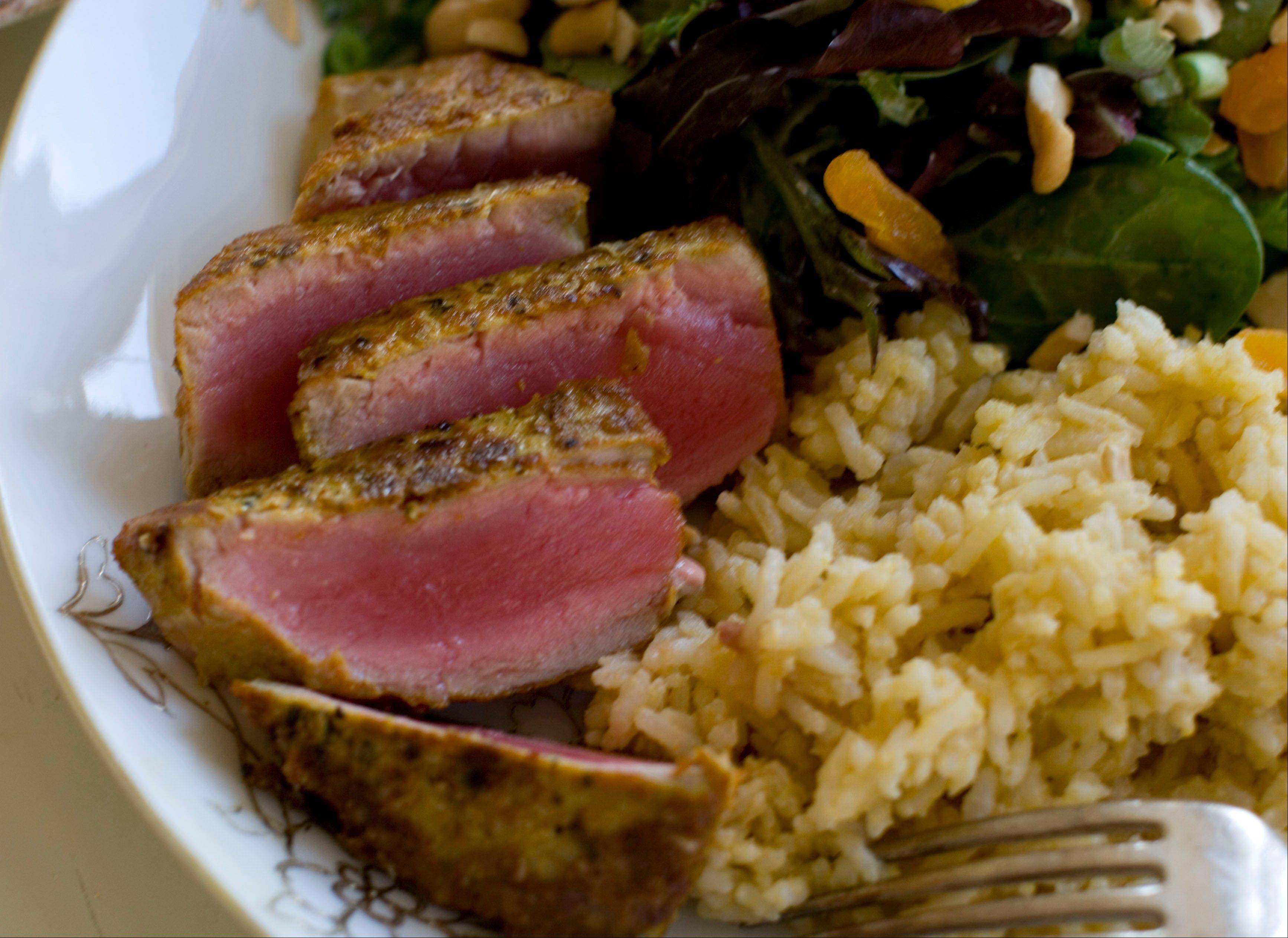 Coconut cashew salad with apricots and seared curry rubbed tuna with mango tahini rice draws on the flavors of the Caribbean, Southeast Asia and Europe for a global New Year's Eve dinner.