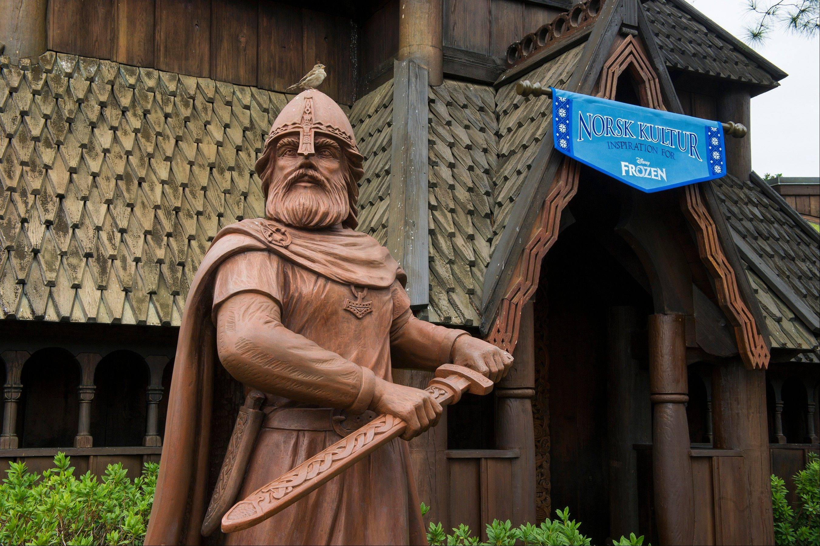 "This Nov. 25, 2013 photo shows the exterior of a new gallery, Norsk Kultur in the Norway pavilion at Epcot at Walt Disney World Resort in Lake Buena Vista, Fla. The new exhibit explores how the culture and beauty of Norway inspired the filmmakers during the creation of Disney's ""Frozen."" Norsk Kultur, meaning �Norweigan Culture, � features items such as an authentic handmade bunad, the traditional costume of Norway; a hardanger fiddle and other handmade instruments; hand-carved artisan furniture; examples of rosemaling (traditional Norse decorative painting)."