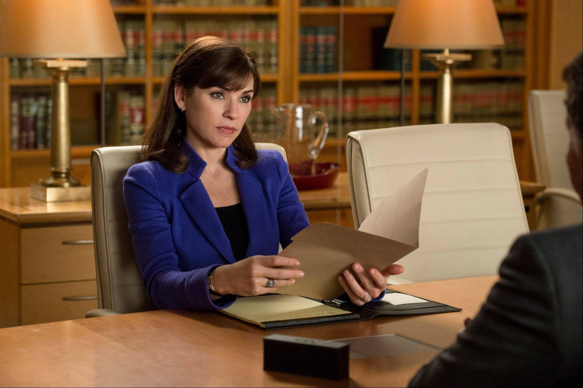 "This image released by CBS shows Julianna Margulies as Alicia Florrick in a scene from ""The Good Wife."" Last season, it seemed to be losing its way. But with its fall return, this brainy, sexy legal drama roared back to life. On ""The Good Wife,"" there's no reliance on car chases, gun play, salaciousness or even crime. It's a series about high ambition and shifting alliances in a grown-up world. And yet it still manages to be lusty, soapy fun, while boasting a splendid cast and a parade of great guest stars."