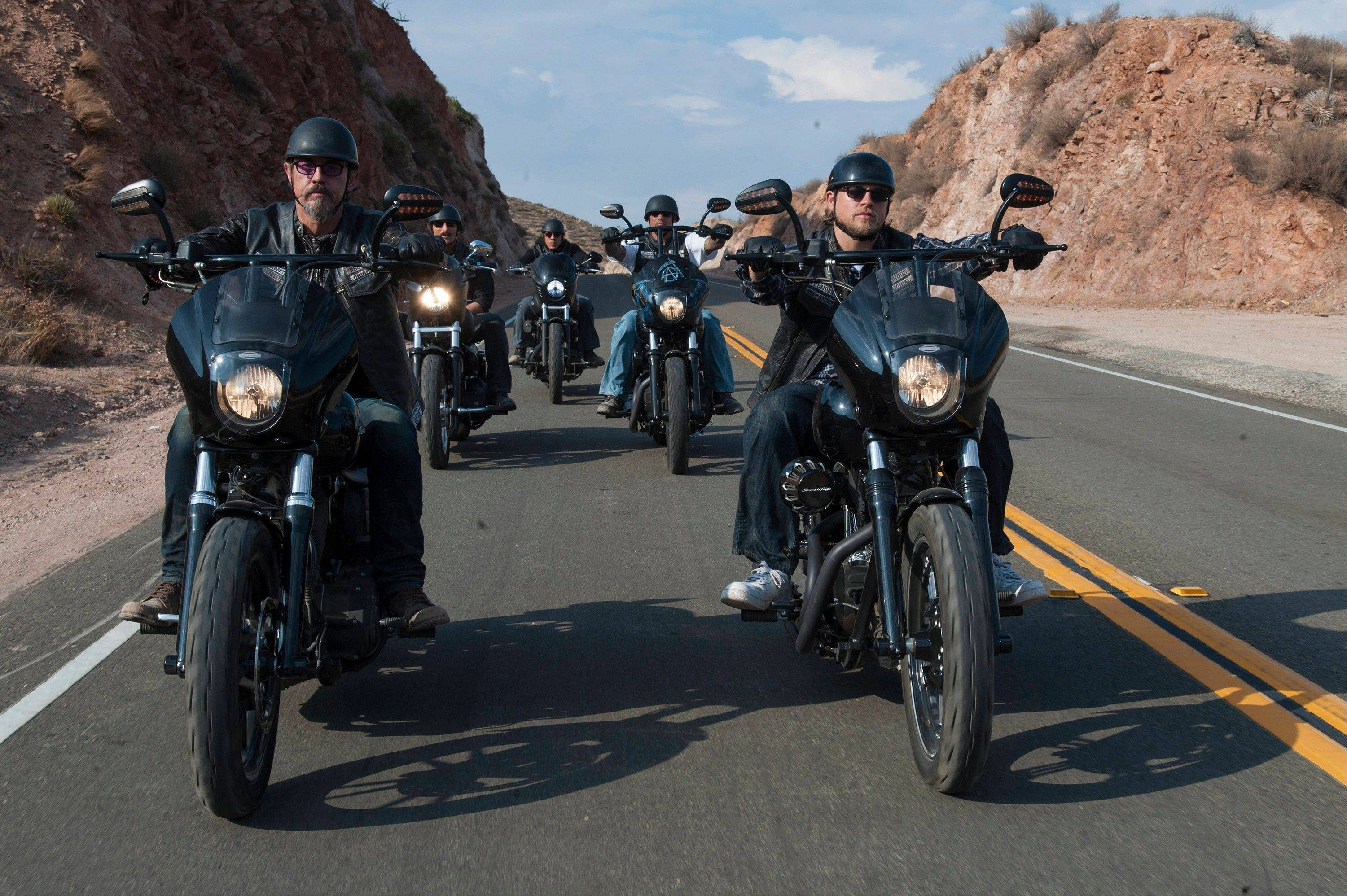 "This image released by FX shows Tommy Flanagan as Filip 'Chibs' Telford, left, and Charlie Hunnam as Jackson ""Jax"" Teller, right, in a scene from ""Sons of Anarchy."" In its sixth season, ""Sons of Anarchy"" was as gory, complex and absorbing as ever, populated with characters who were brutish, bloodthirsty and yet somehow commanded our respect and affection."