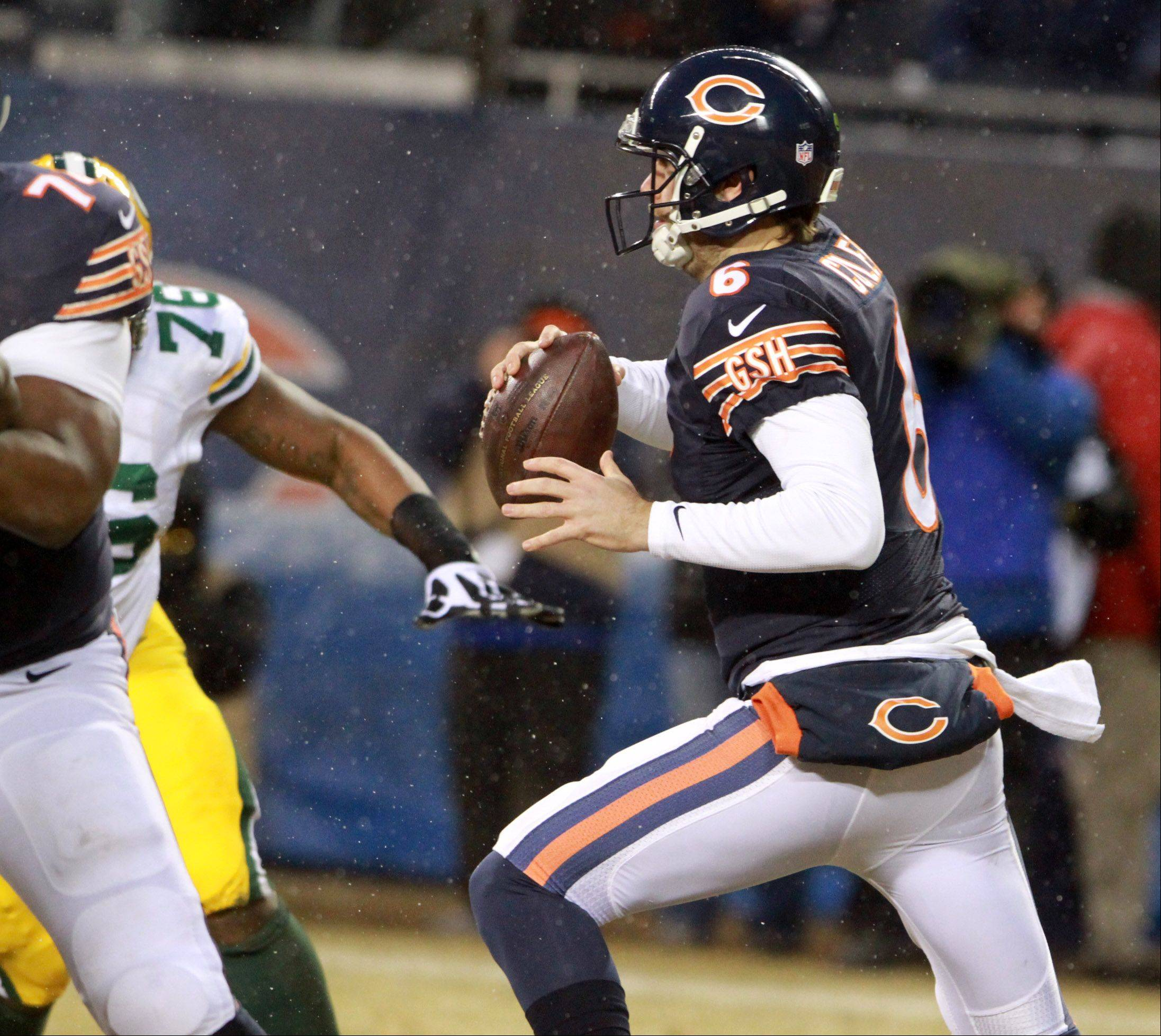 Chicago Bears quarterback Jay Cutler scrambles with the ball against the Green Bay Packers on Sunday at Soldier Field in Chicago.