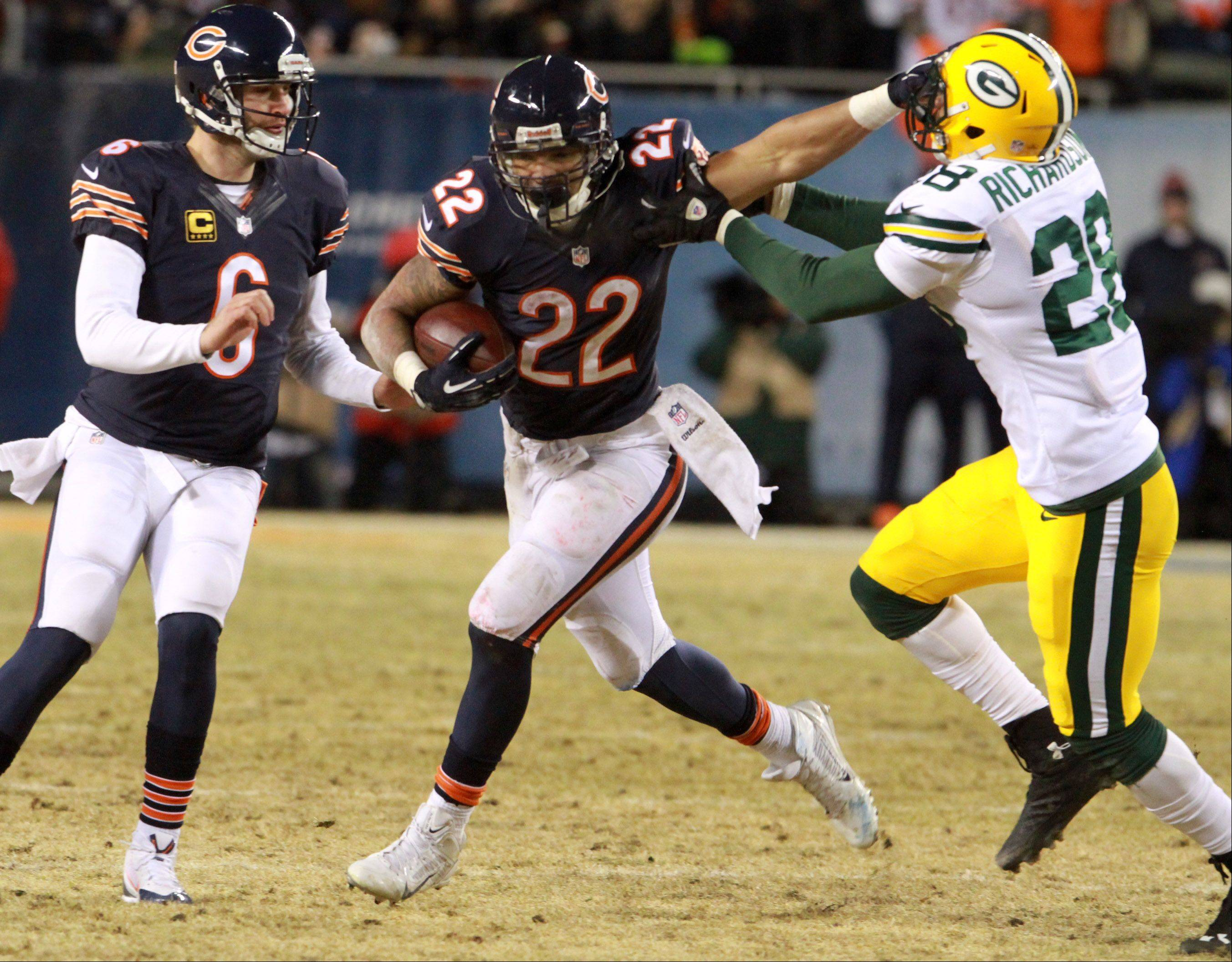 Chicago Bears running back Matt Forte escapes from Green Bay Packers safety Sean Richardson on Sunday at Soldier Field in Chicago.