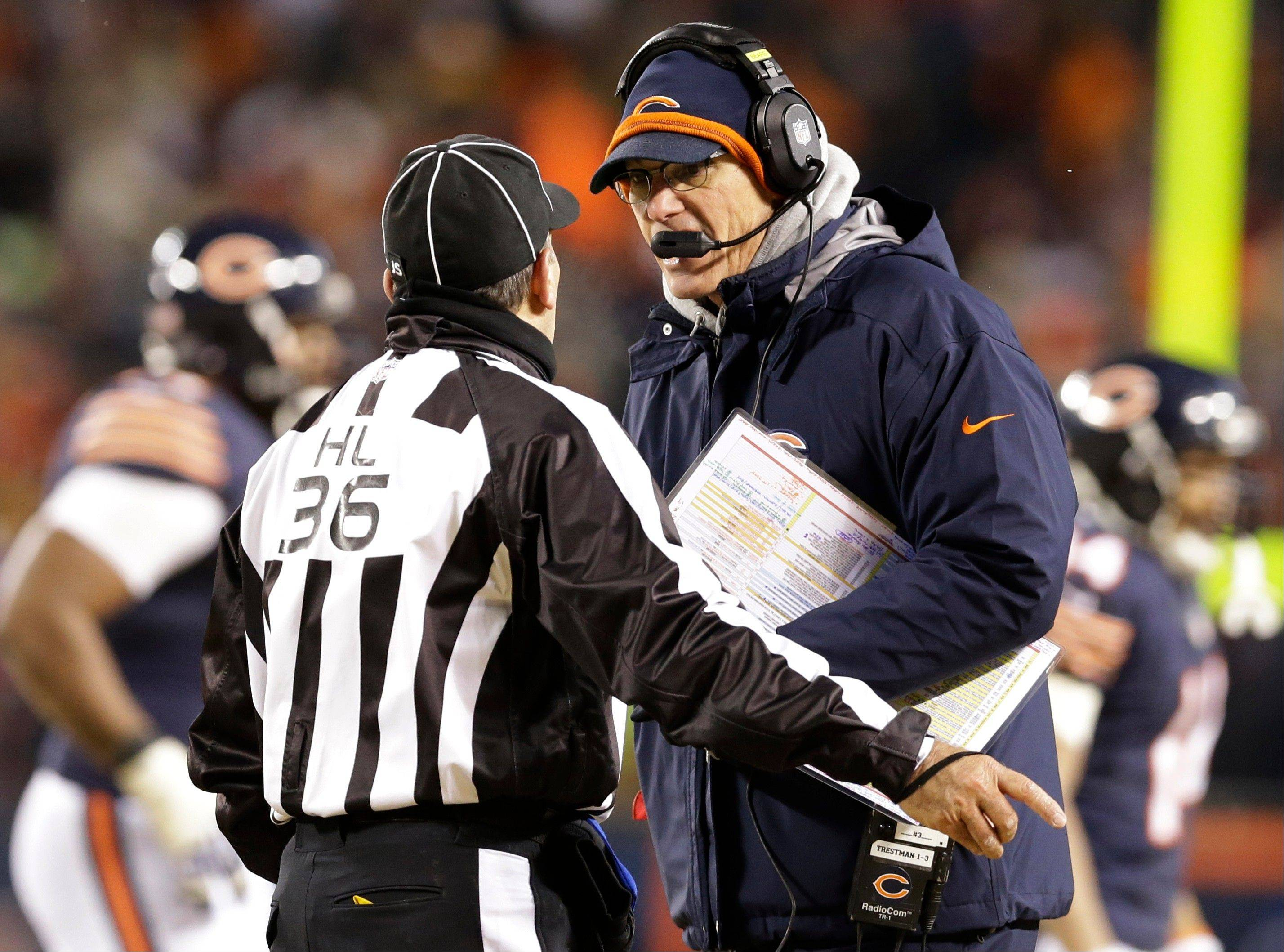 Chicago Bears head coach Marc Trestman argues a call with head linesman Tony Veteri (36) during the second half.