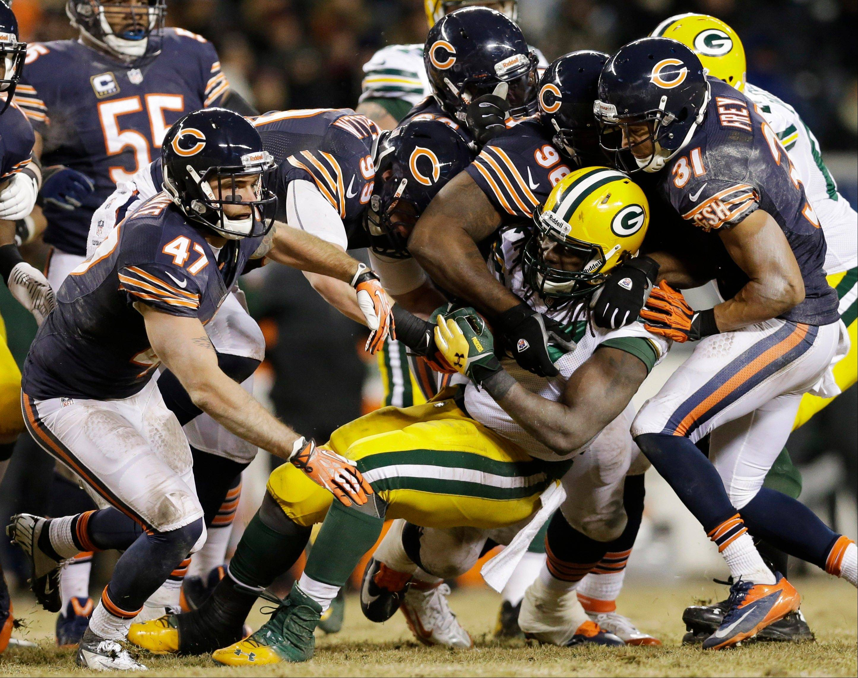 Green Bay Packers running back Eddie Lacy (27) gets tackled by Chicago Bears defenders during the second half.