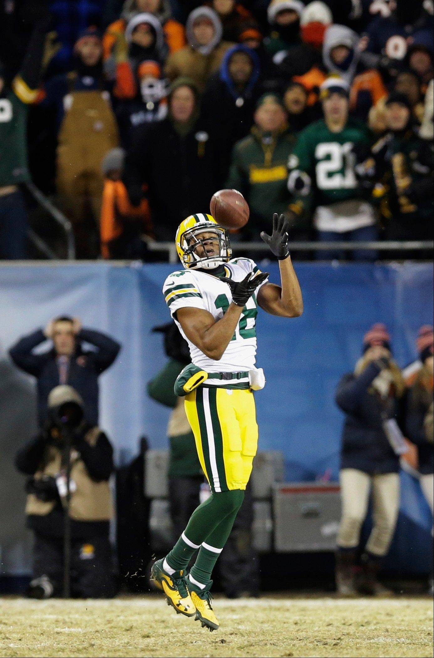 Green Bay Packers wide receiver Randall Cobb (18) makes the winning touchdown reception during the second half of an NFL football game against the Chicago Bears, Sunday, Dec. 29, 2013, in Chicago. The Packers won 33-28 to capture the NFC North title.