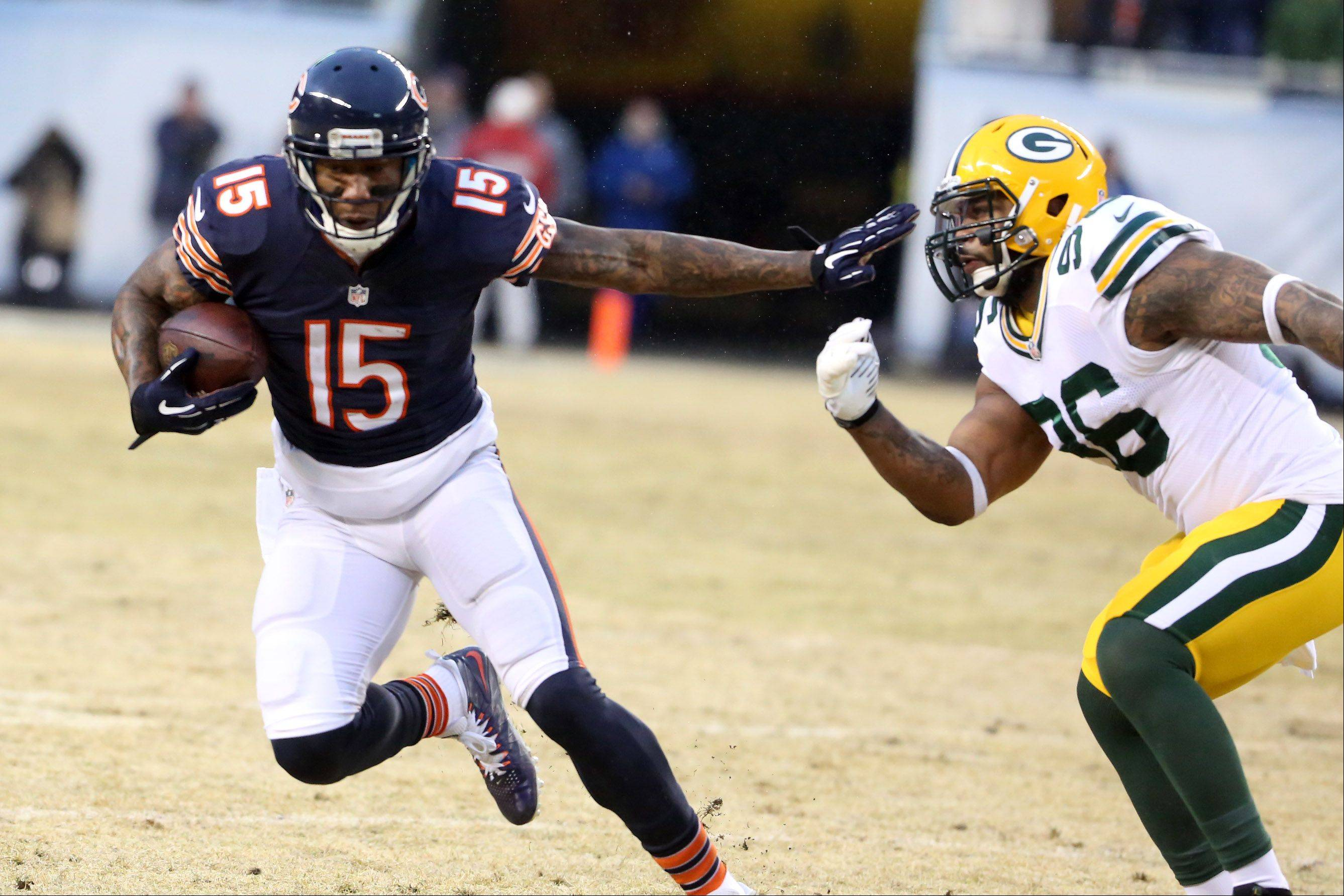 Chicago Bears wide receiver Brandon Marshall runs the ball after a catch against Green Bay Packers outside linebacker Mike Neal on Sunday at Soldier Field in Chicago.