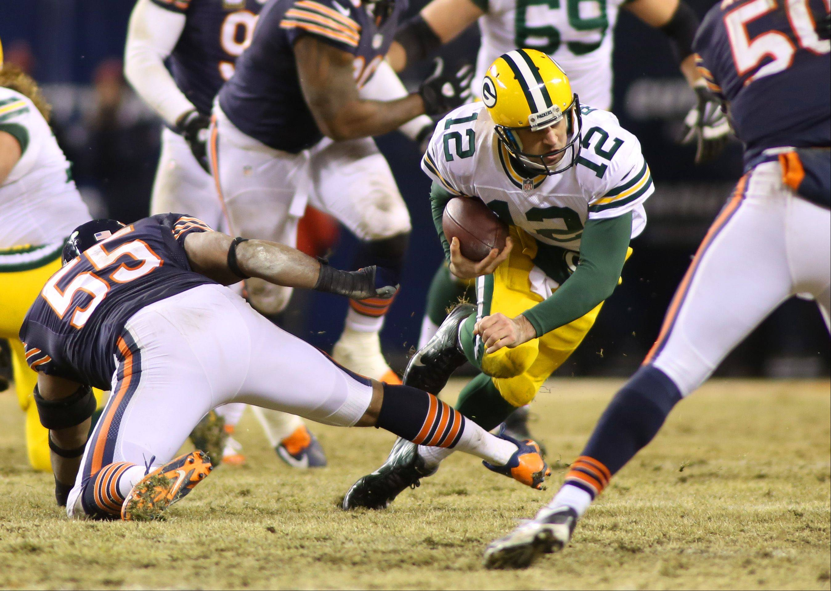 Aaron Rodgers runs for a first down during the second half.