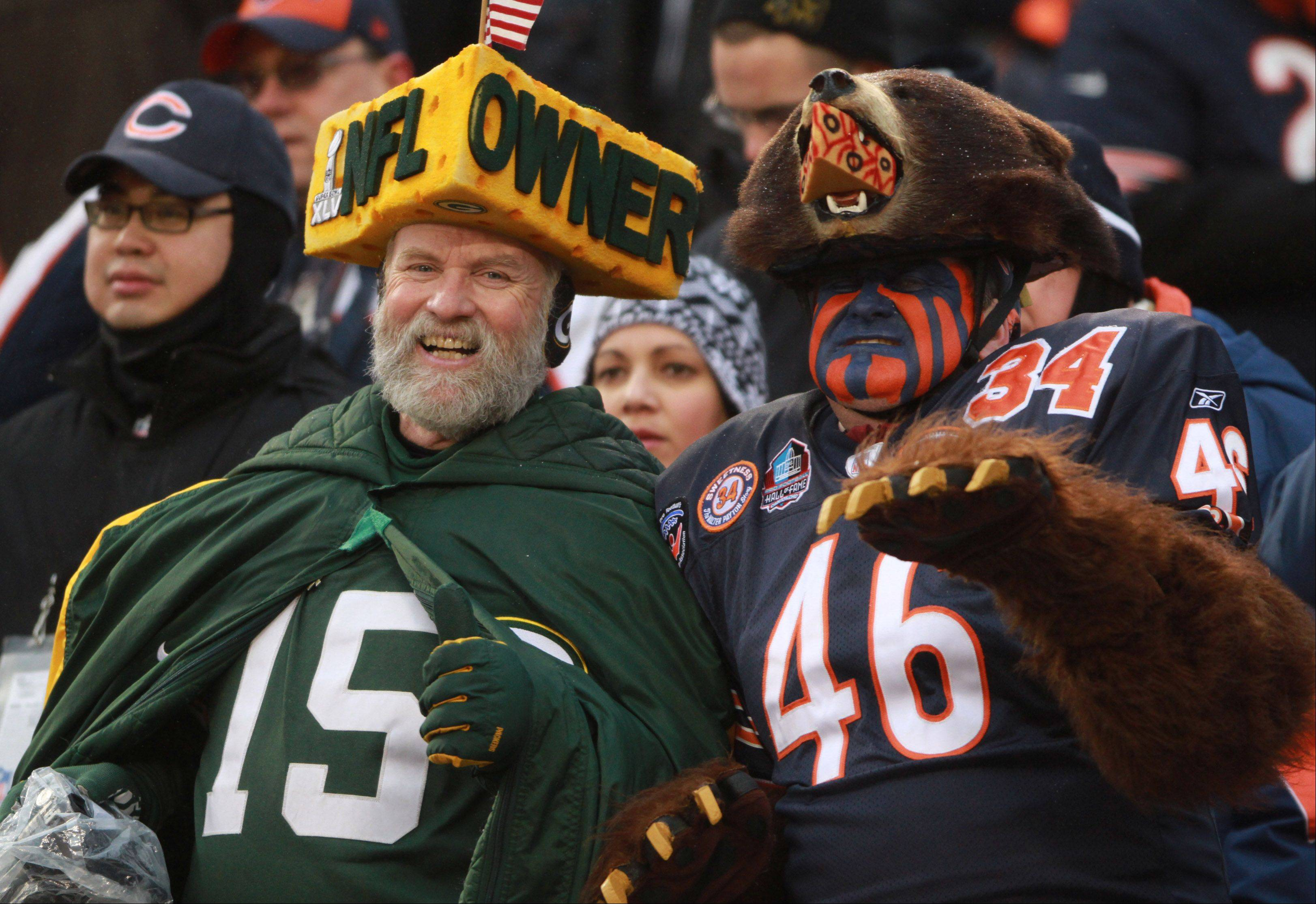 A Green Bay Packers fan next to a Bears fan is all smiles at the end of the game on Sunday at Soldier Field in Chicago.