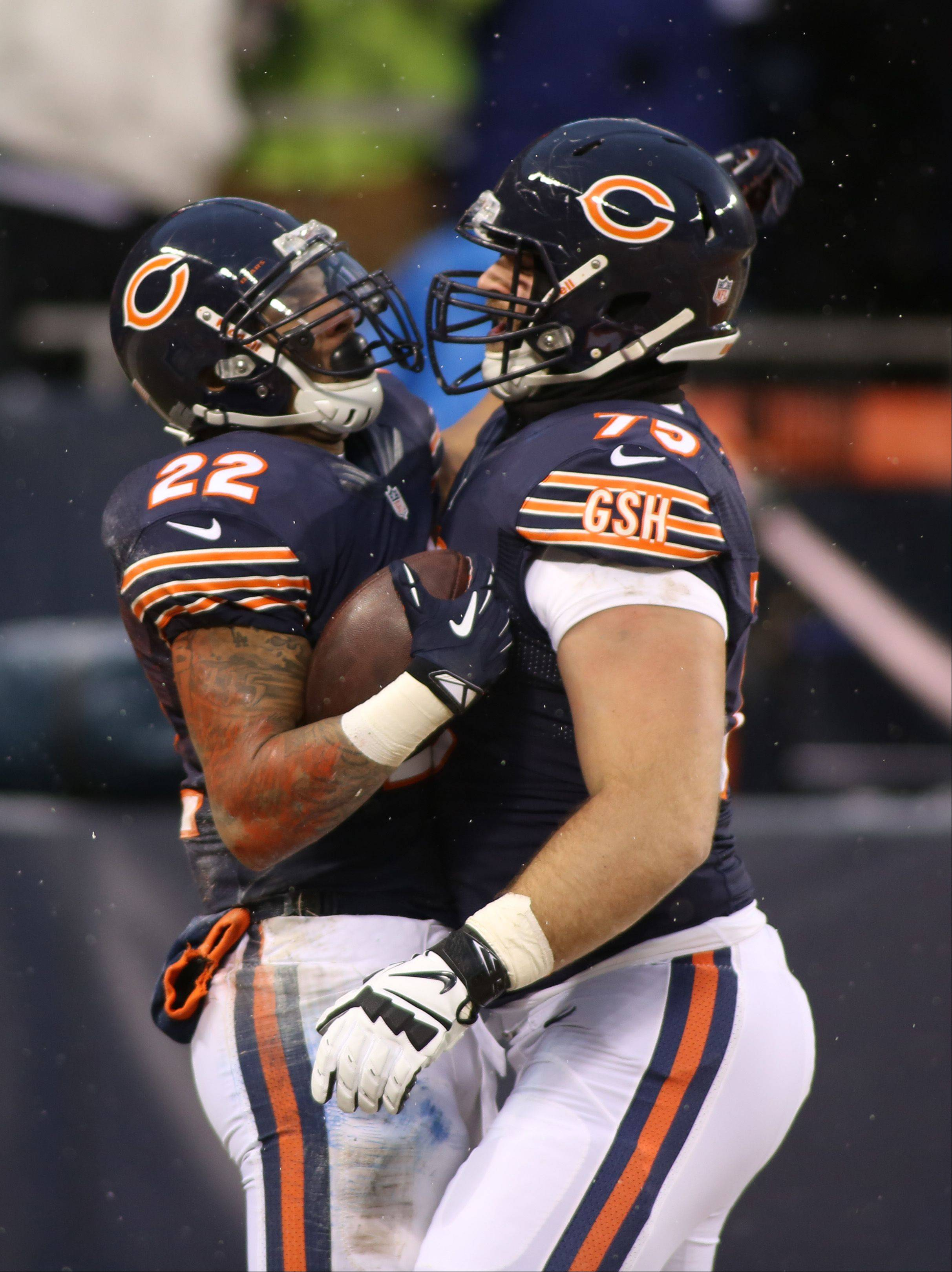 The Bear's Matt Forte, left, celebrates a touchdown with Kyle Long.