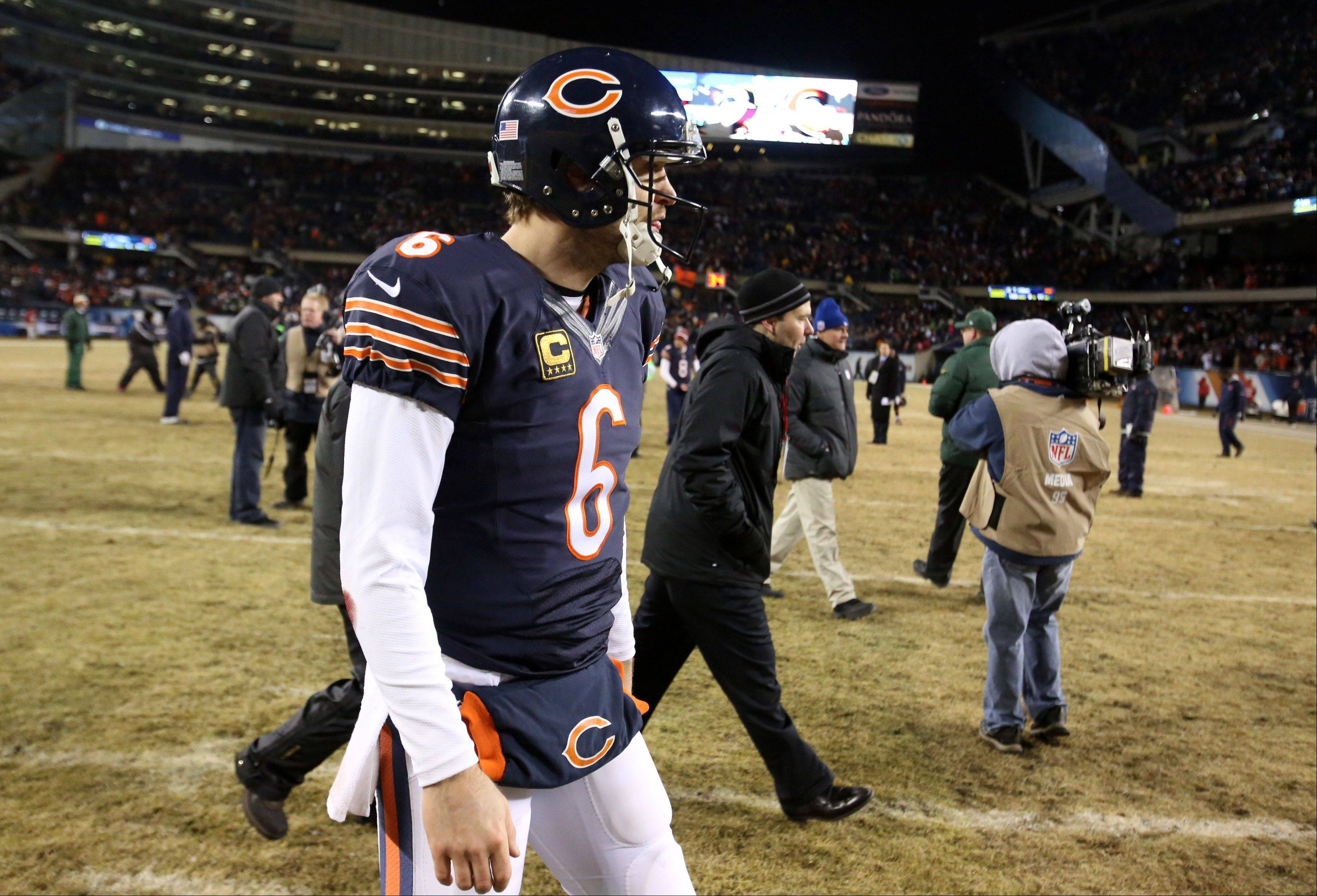 Chicago Bears quarterback Jay Cutler walks off the field after losing to the Green Bay Packers 33-28 on Sunday at Soldier Field in Chicago.