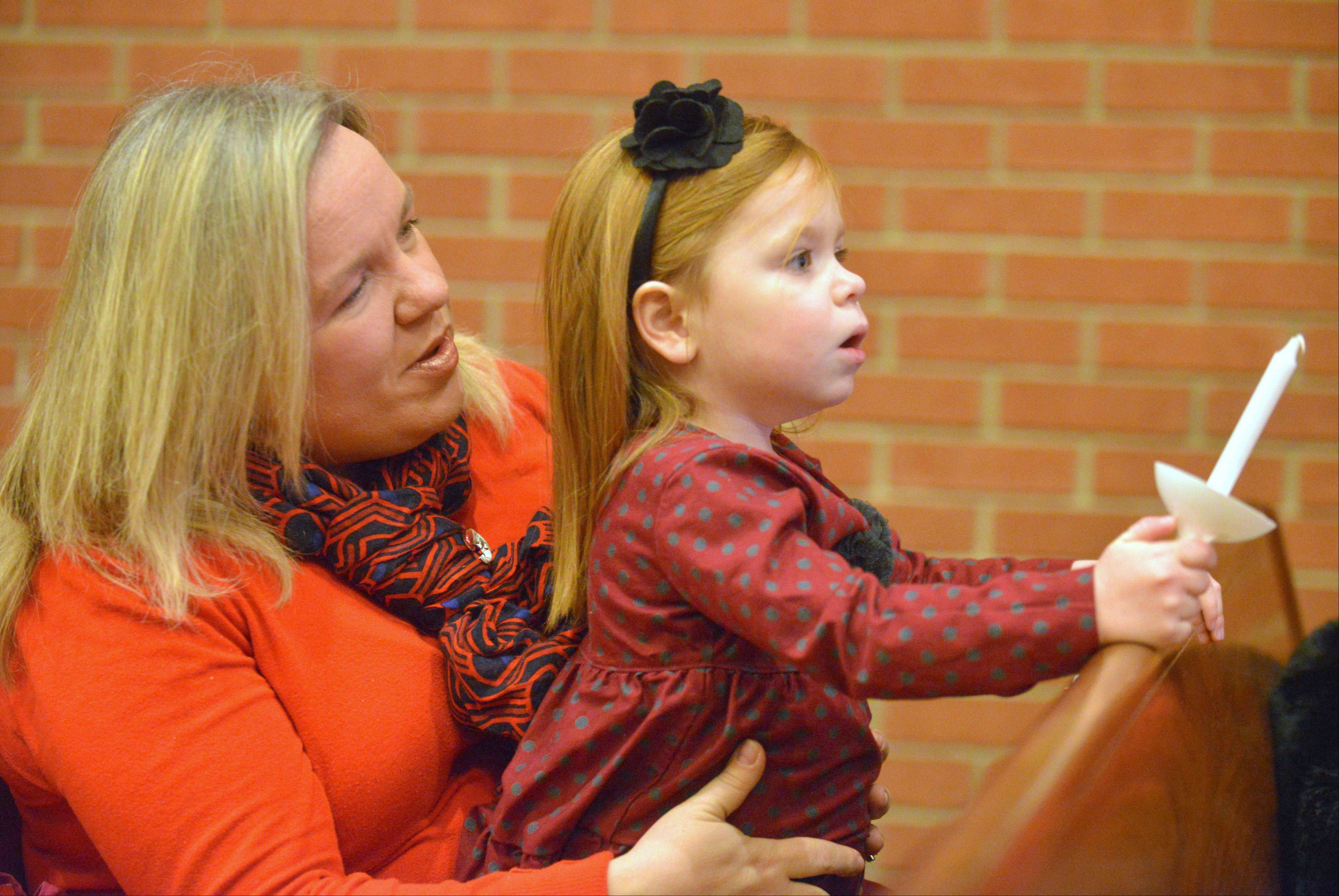 Ruth Ciamarra and her daughter Anna, 4, took part in the Holy Trinity Lutheran Church family Christmas Eve service Tuesday in Lombard.