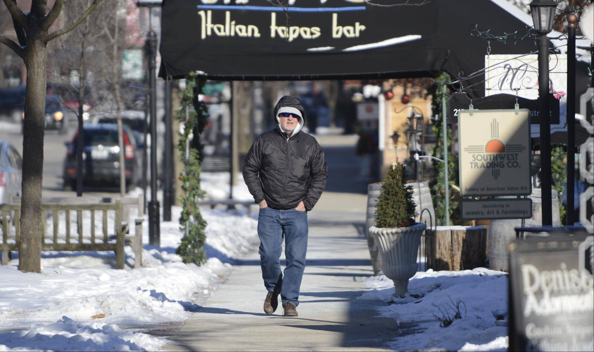 """I left my gloves in the car,"" said Greg Clark of St. Charles. ""I was thinking it won't be that bad, but it's cold."" Clark was doing last-minute shopping in downtown Geneva Wednesday."
