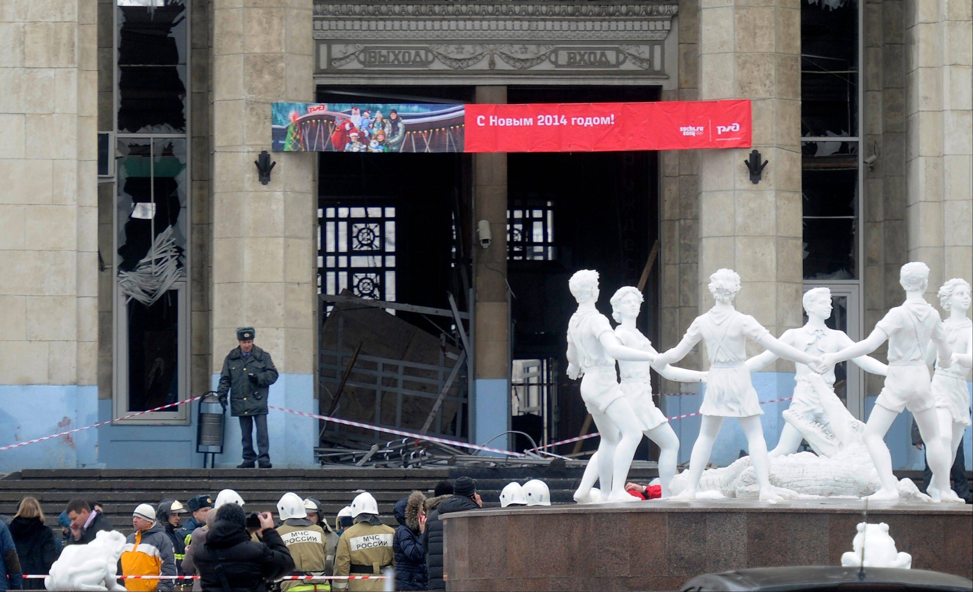 A police officer guards a main entrance to the Volgograd railway station hit by an explosion Sunday in Volgograd, Russia. More than a dozen people were killed and scores were wounded Sunday by a female suicide bomber at a railway station in southern Russia, officials said, heightening concern about terrorism ahead of February's Olympics in the Black Sea resort of Sochi.