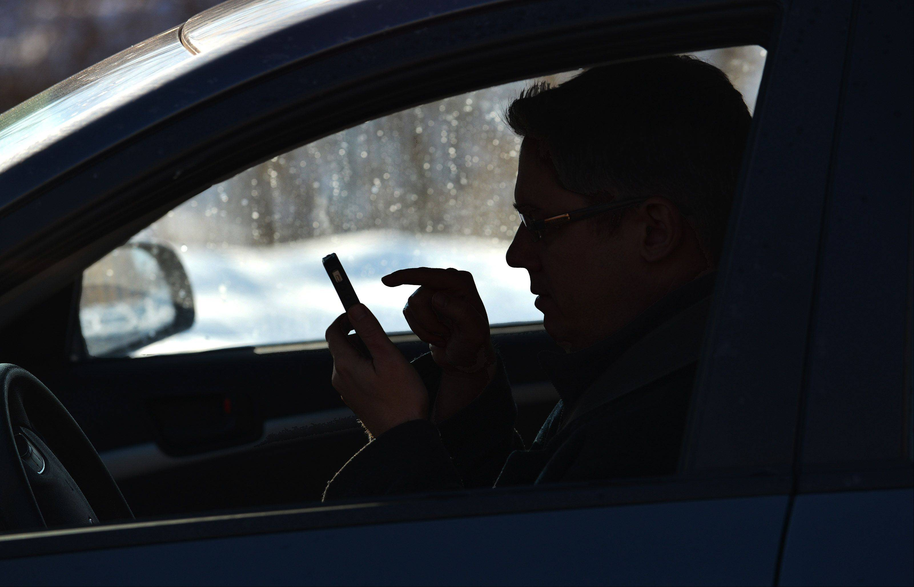"Texting remains illegal in 2014, but so will dialing a phone while driving, even if you're hands-free during the call. ""That is when you are taking your eyes off the roadway, and it is dangerous,"" says Arlington Heights police Cmdr. Andrew Whowell."