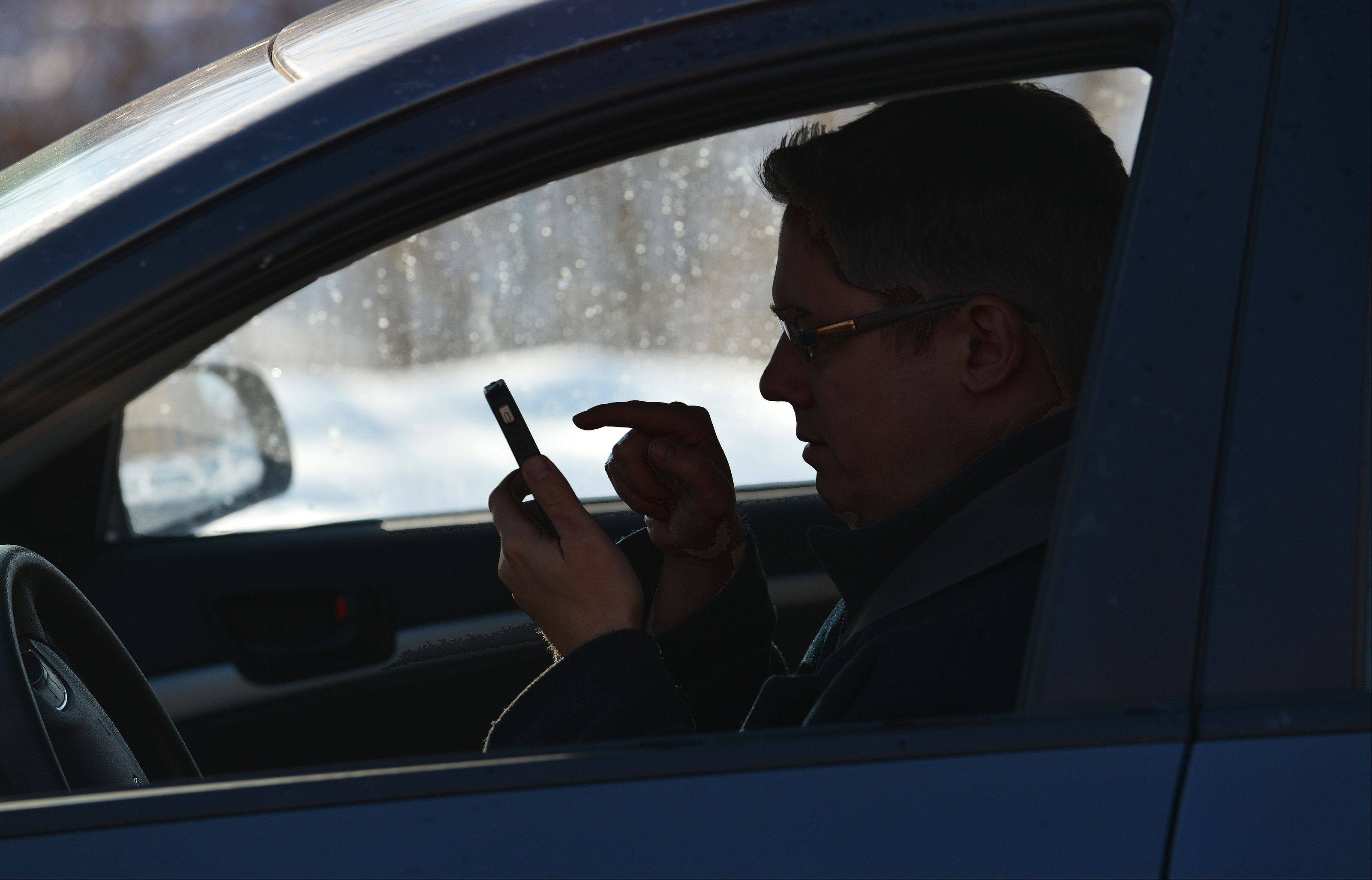 "Texting remains illegal in 2014, but so is dialing a phone while driving, even if you're hands-free during the call. ""That is when you are taking your eyes off the roadway, and it is dangerous,"" says Arlington Heights police Cmdr. Andrew Whowell."