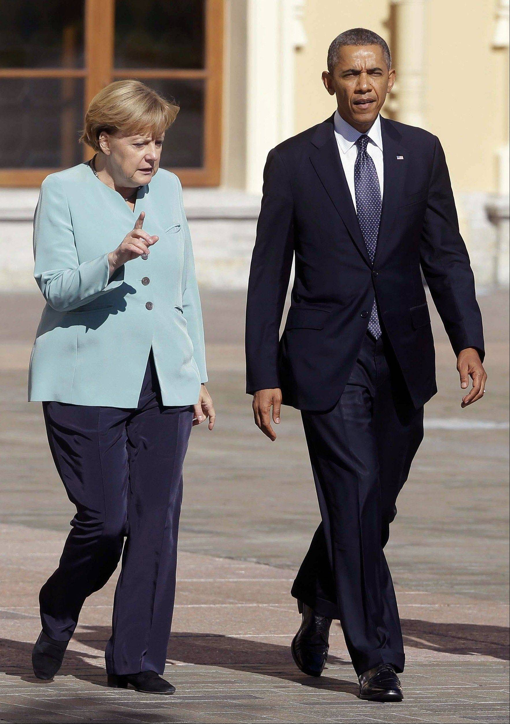 On Sept. 6, President Barack Obama walks with German Chancellor Angela Merkel prior to the group photo at the G-20 summit at the Konstantin Palace in St. Petersburg, Russia.