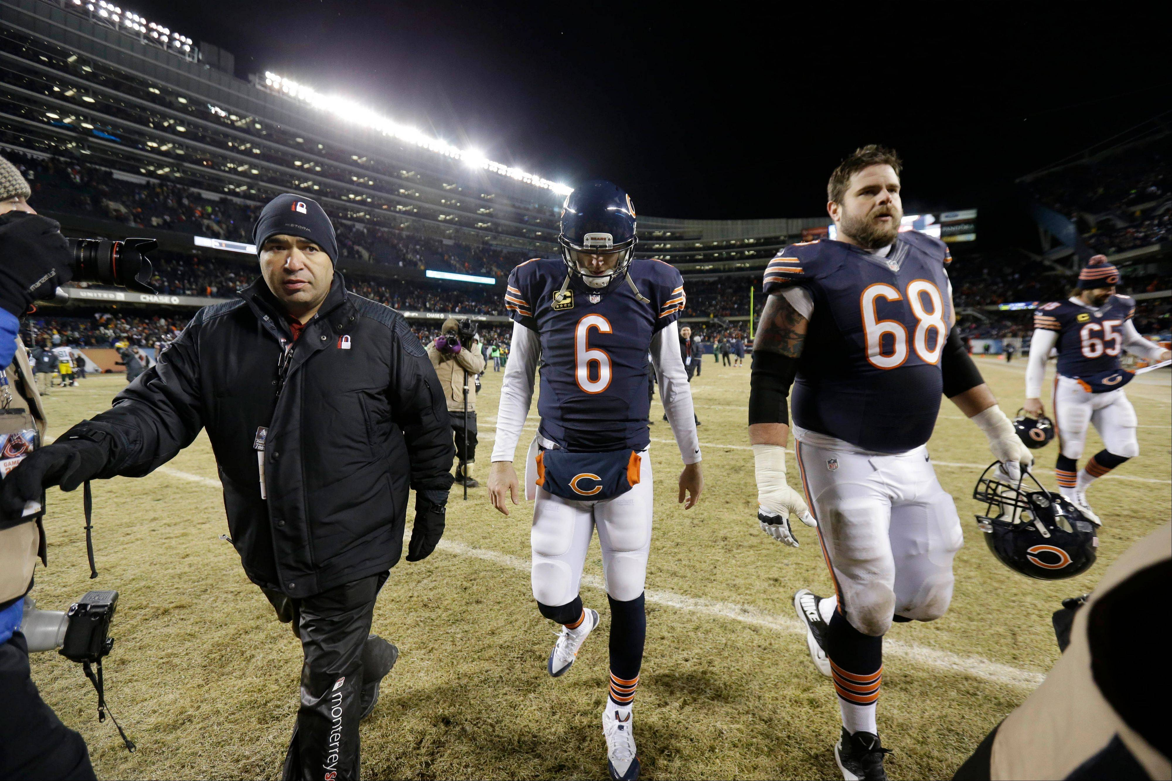 Jay Cutler walks off the field after the Bears' 33-28 loss to the Green Bay Packers in an NFL football game Sunday in Chicago.