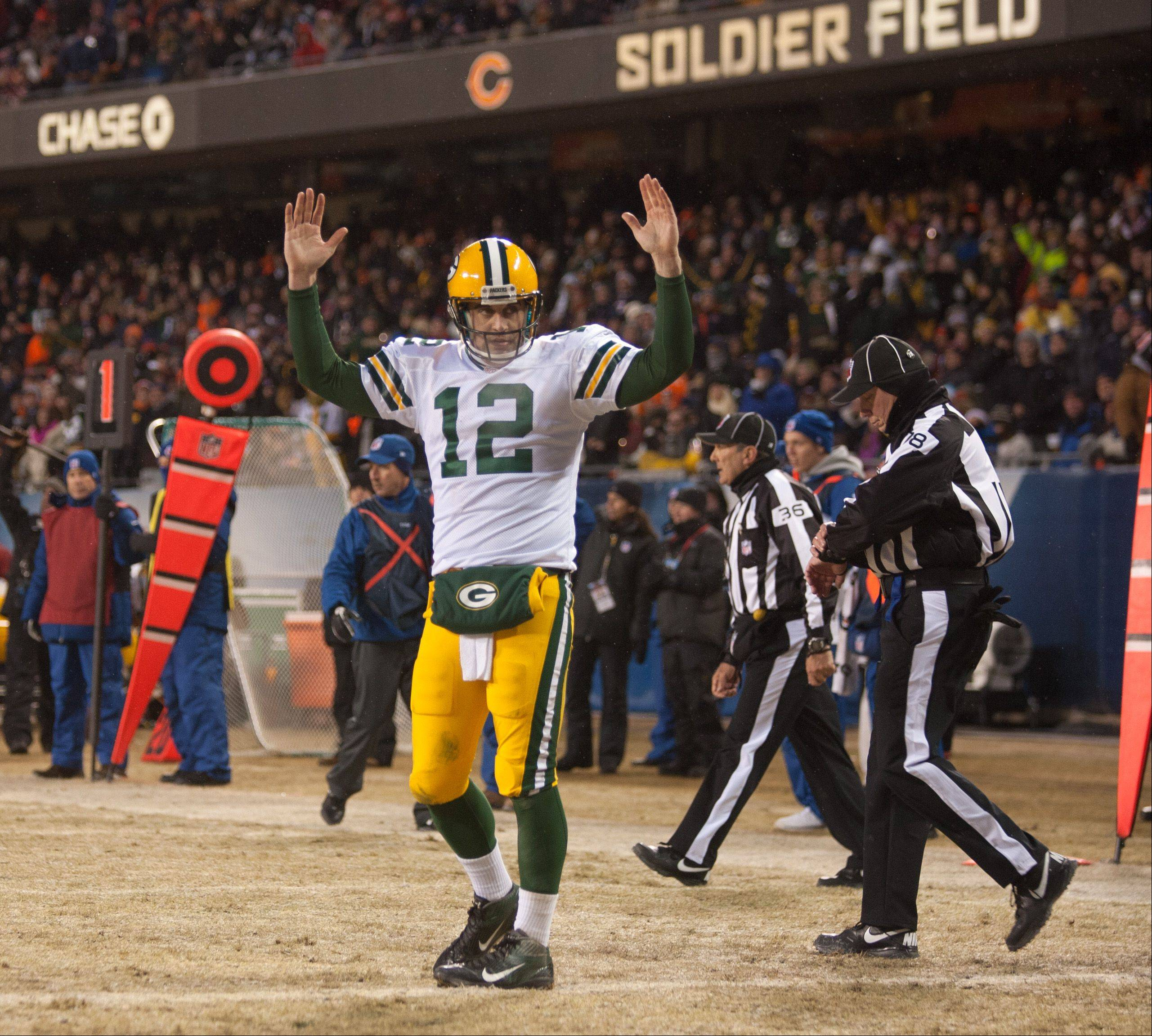 Aaron Rodgers signals a touchdown on his first-half fumble, which was run into the end zone by Packers WR Jarrett Boykin.