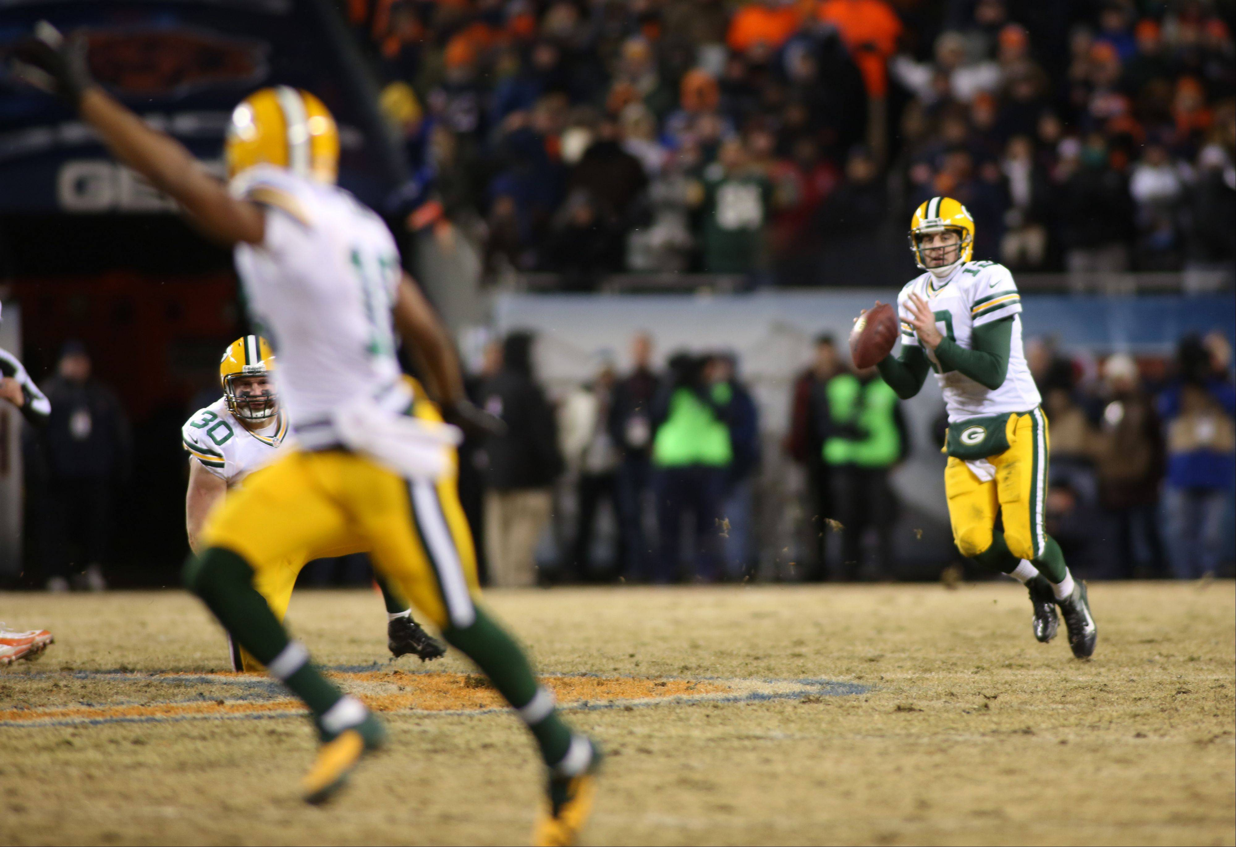 Aaron Rodgers looks down field before throwing his game winning touchdown to Randall Cobb.