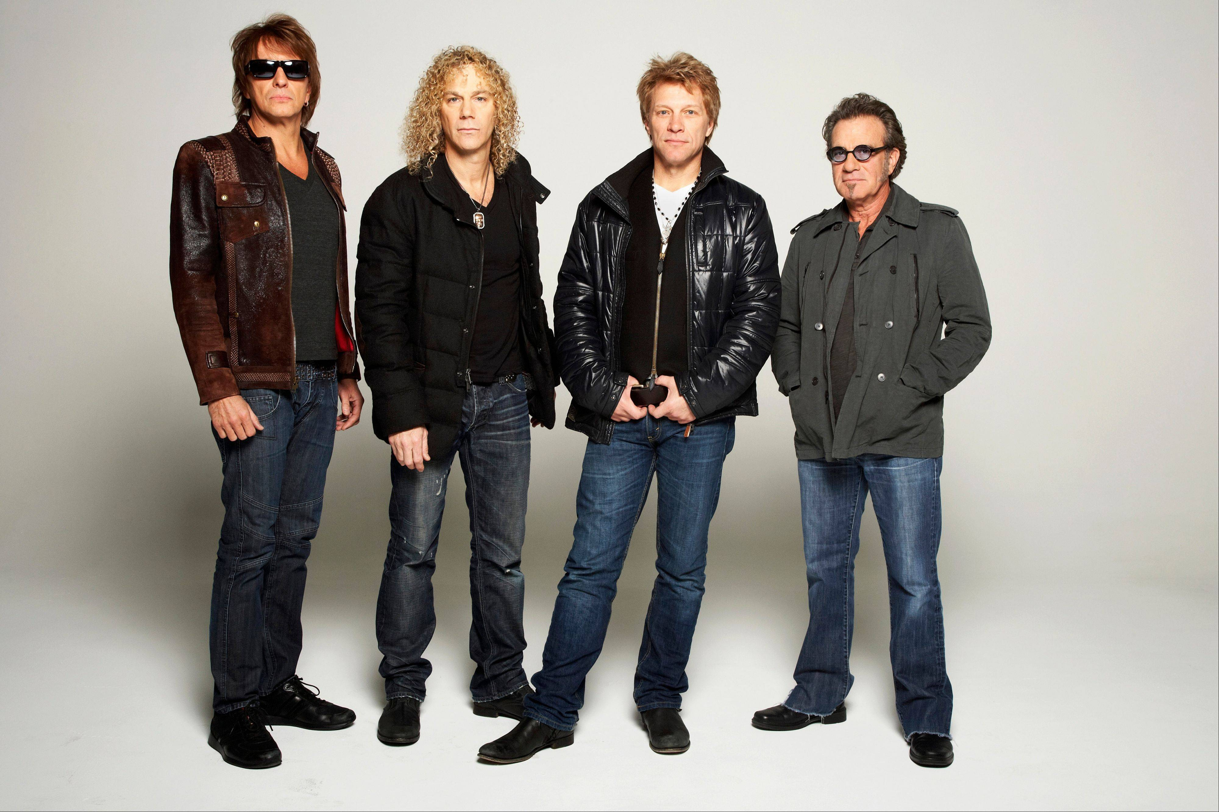 In this Nov. 29, 2012 file photo, rock band Bon Jovi, from left, Richie Sambora, David Bryan, Jon Bon Jovi and Tico Torres pose for a portrait, in the Brooklyn Borough of New York. The New Jersey band had the top-grossing tour in 2013 despite some bumps including drummer Tico Torres� two surgeries and the absense of guitarist Richie Sambora.