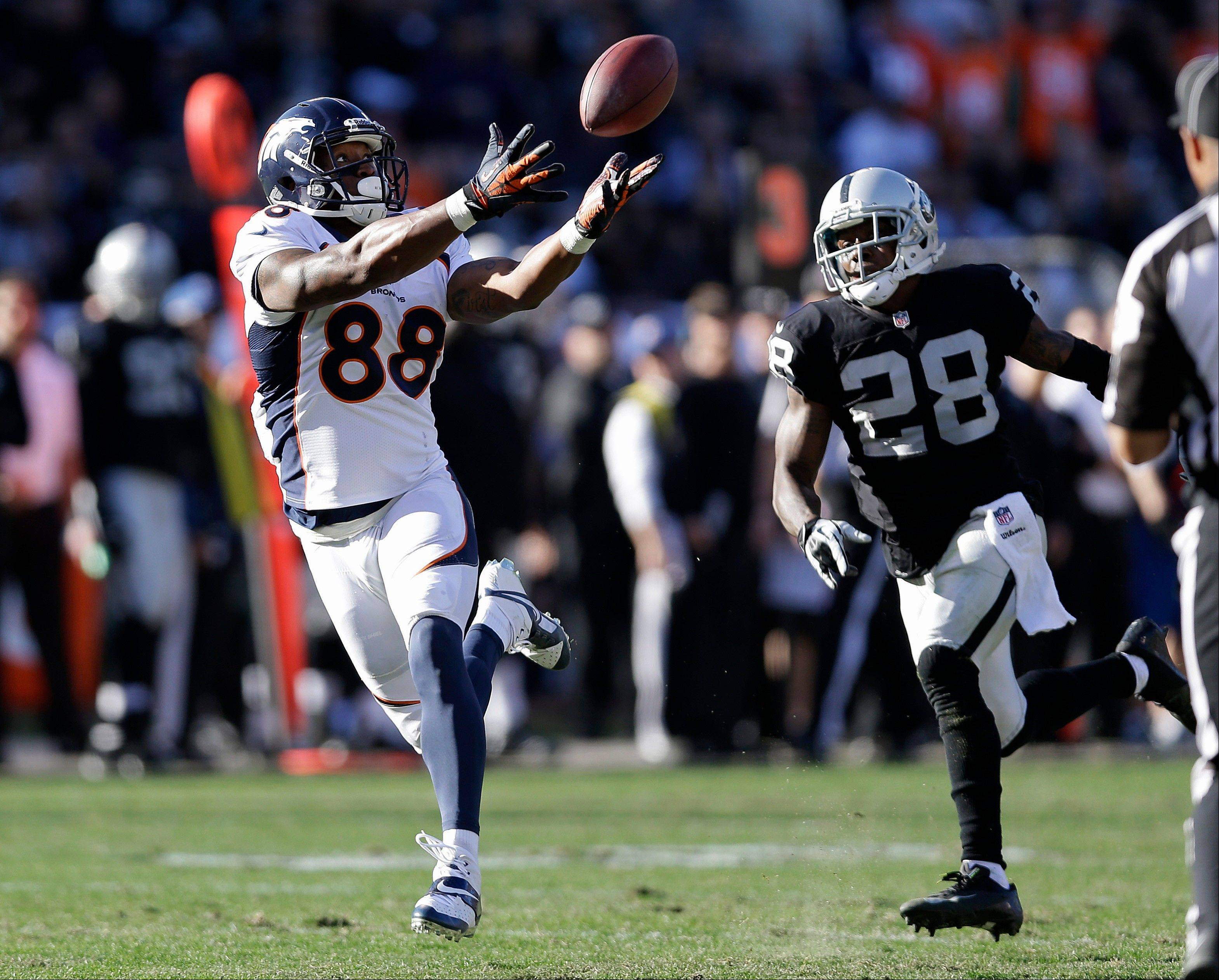 Denver Broncos wide receiver Demaryius Thomas catches a 63-yard touchdown pass from quarterback Peyton Manning during the second quarter of Sunday�s game in Oakland. With this TD, the Broncos surpassed the 2007 New England Patriots for the most points scored in a season.