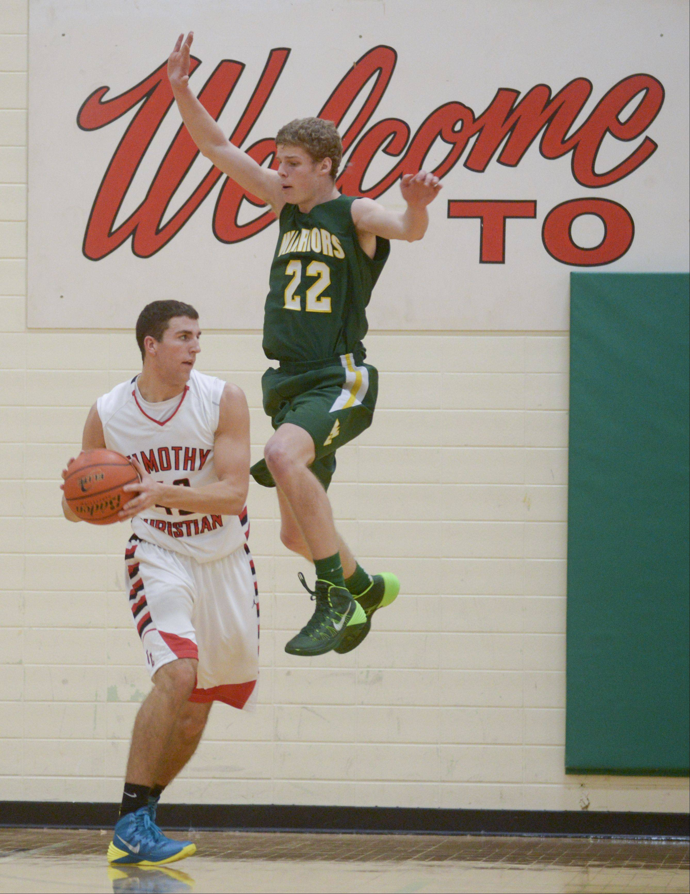 Timothy Christian�s Connor VanderBrug looks to pass around Waubonsie Valley�s Jack Cordes during the Jack Tosh Holiday Classic at York High School Monday.