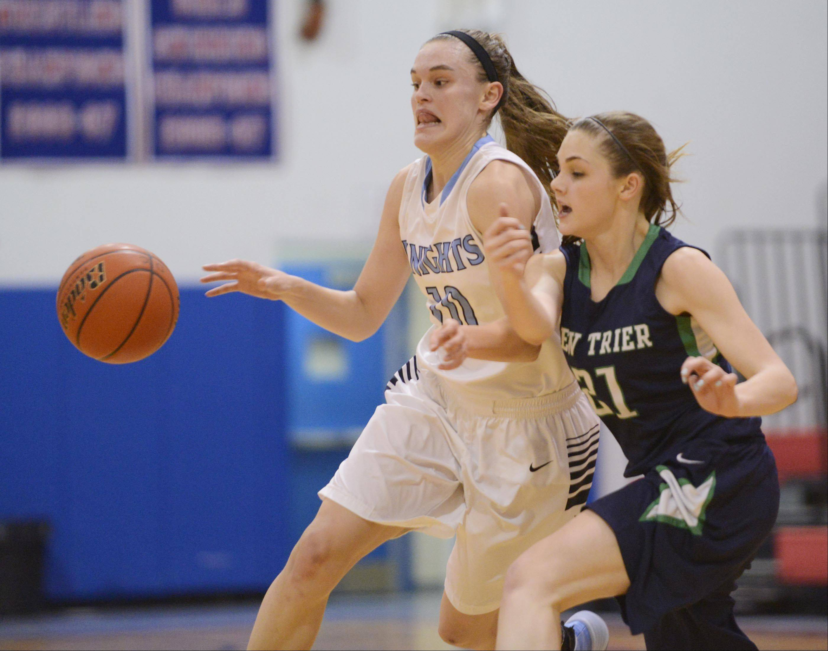 New Trier�s Isabella Bosco knocks the ball from Prospect�s Taylor Will Monday in the championship game of the 31st Annual Charger Classic at Dundee-Crown on Monday.